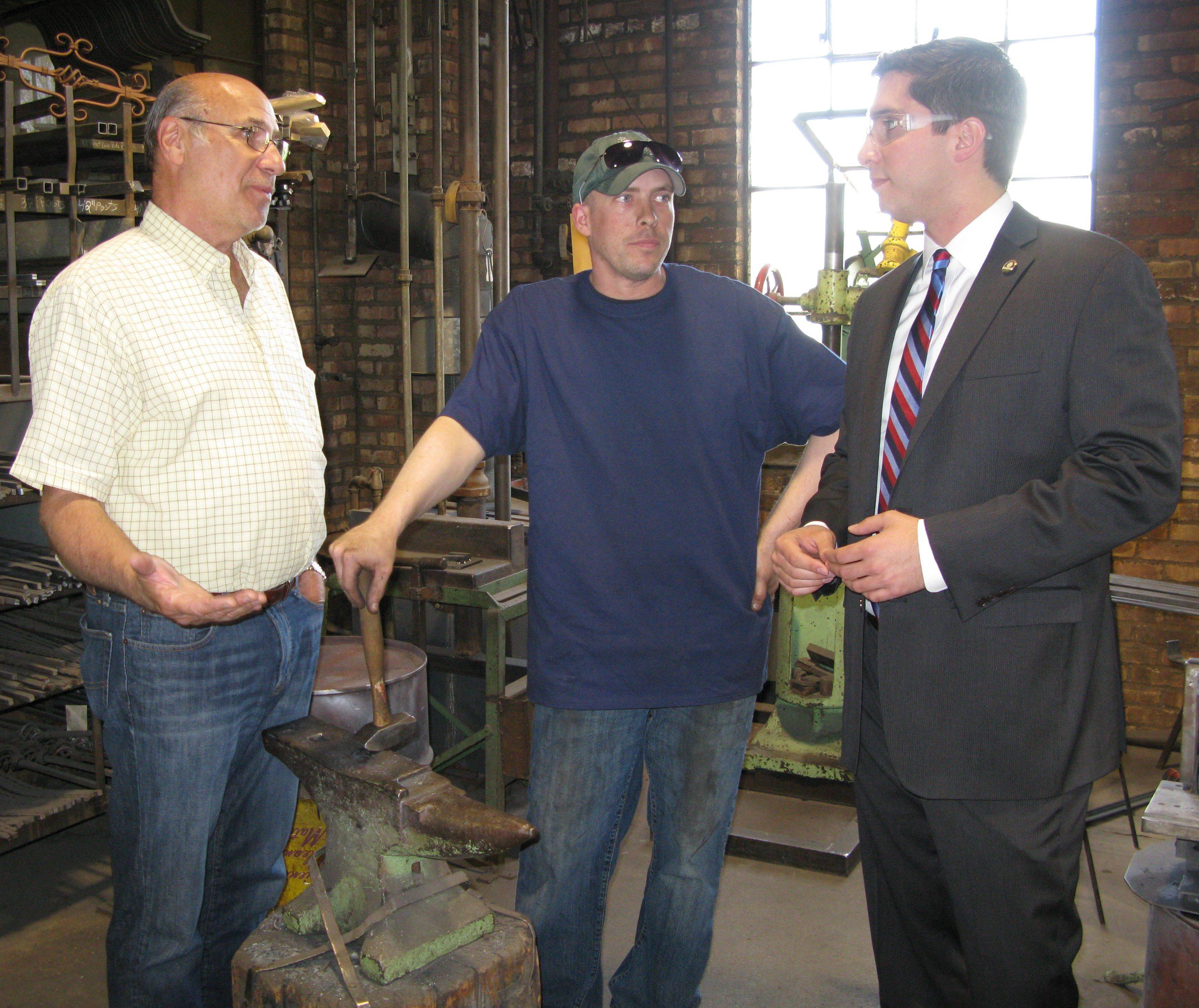 Des Plaines Mayor Matt Bogusz, right, meets with local business owner Steve Burval, left, owner of J.B. Metal Works, and his longtime employee, Mike Jaeger, on his first day as mayor. Bogusz said Tuesday a streamlining of the city's regulations should make it easier to open a business.