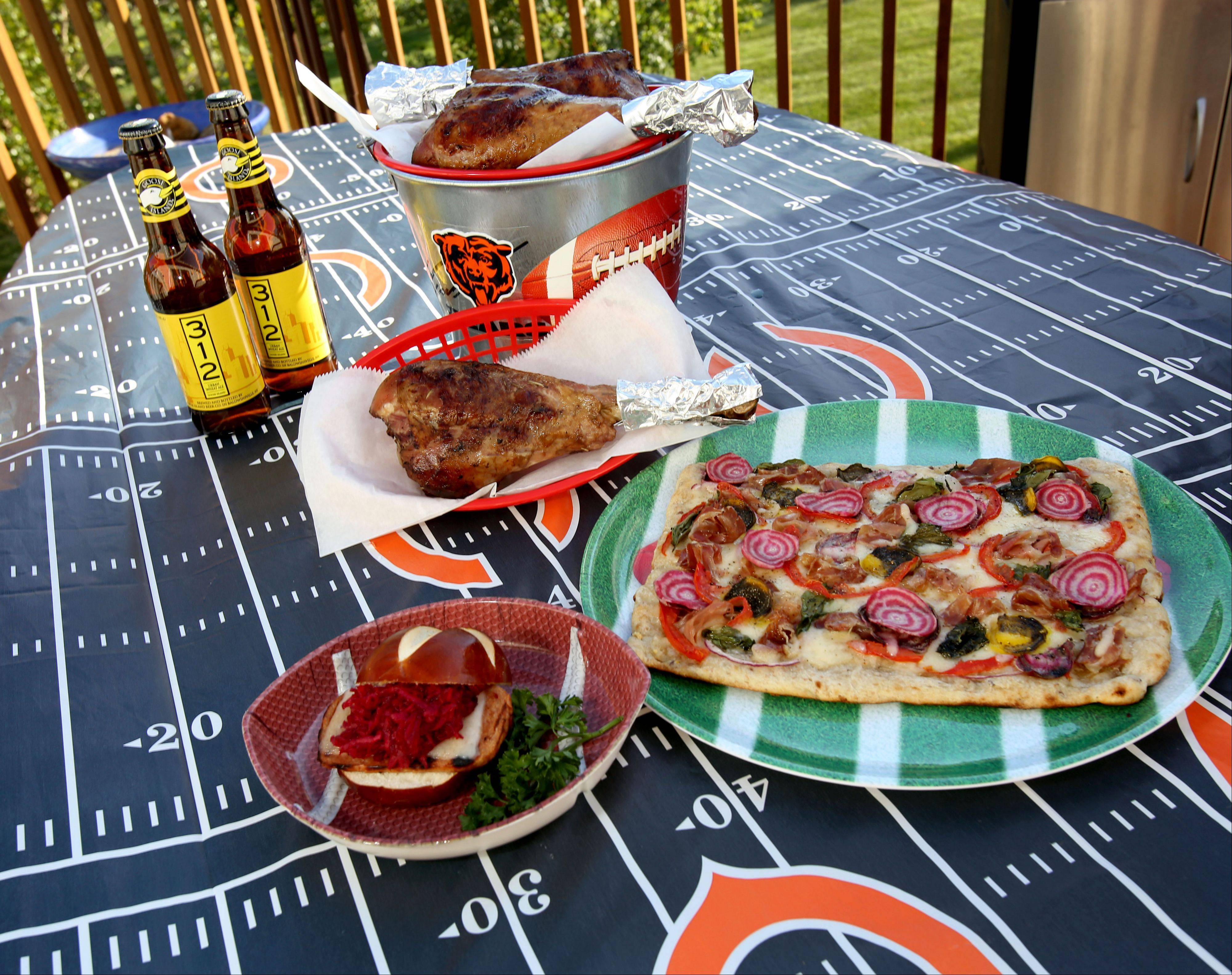 Lori Wiktorek�s game day spread includes grilled pizza, topped with thinly sliced beets and prosciutto, beet slaw and havarti-topped Spam sliders and apple cider-brined turkey legs.