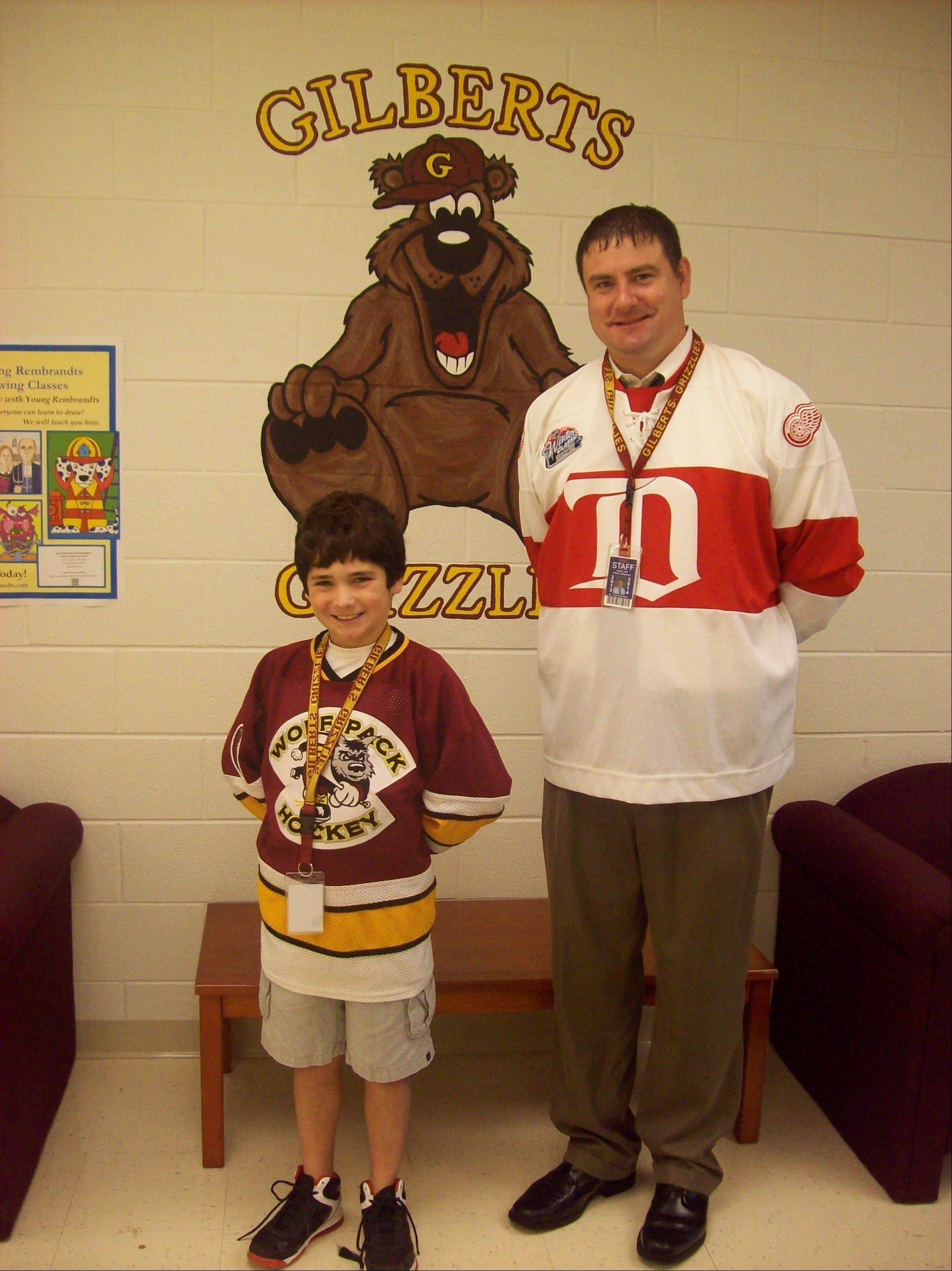 Blackhawks fan Vincenzo Pellegrino, left, a fifth-grader at Gilberts Elementary School, won a bet with Principal Craig Zieleniewski, a Red Wings fan, as to who would win the Stanley Cup. Pellegrino�s prize? To be principal for a day.