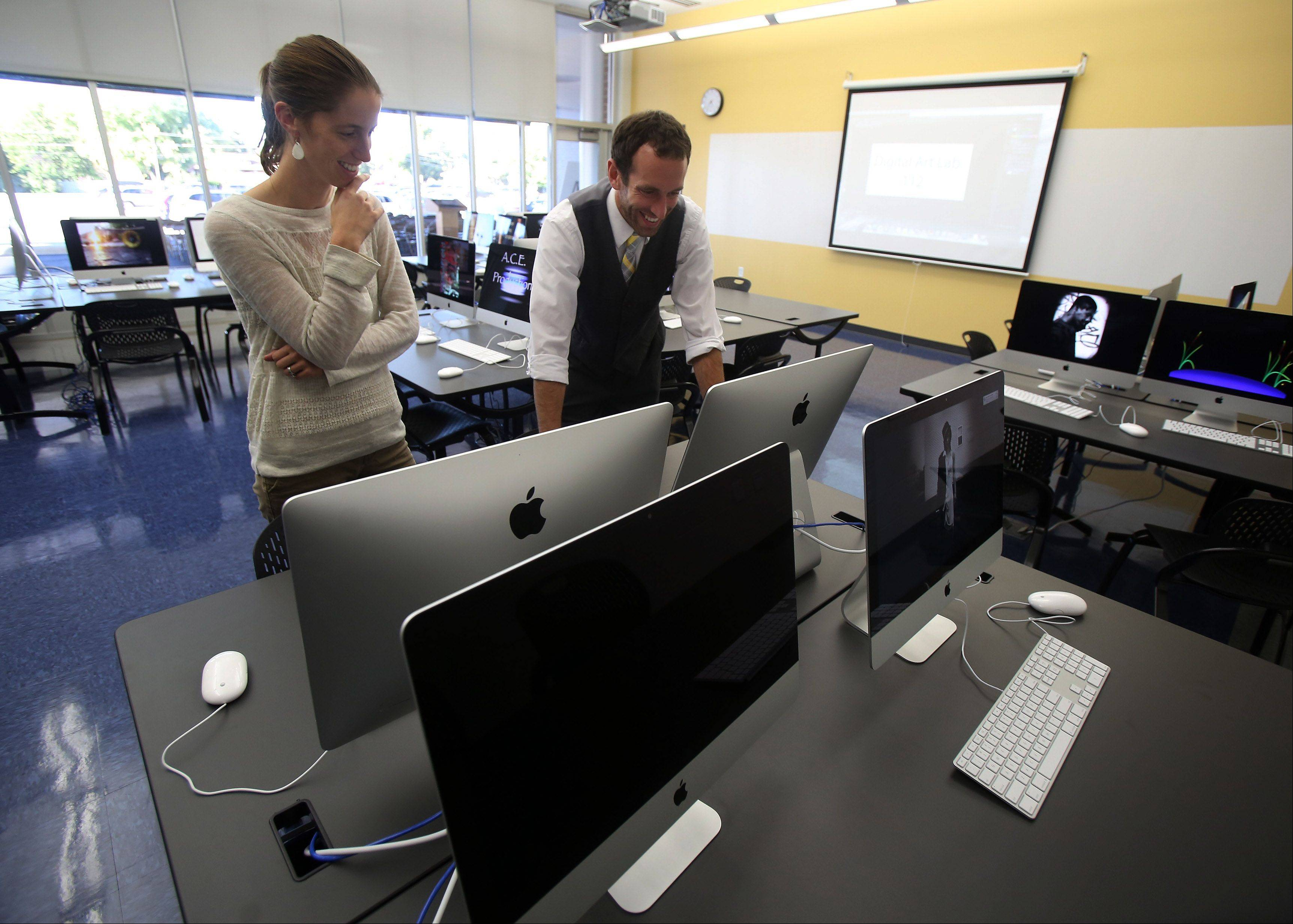 Technical teachers Carole McCulley and Brett Heimstead work with the new computers in the new digital lab during a dedication ceremony for the new addition at Warren High School — O'Plaine Campus Tuesday in Gurnee. The addition includes 10 new science classrooms, a digital lab classroom, meeting rooms and teacher offices.