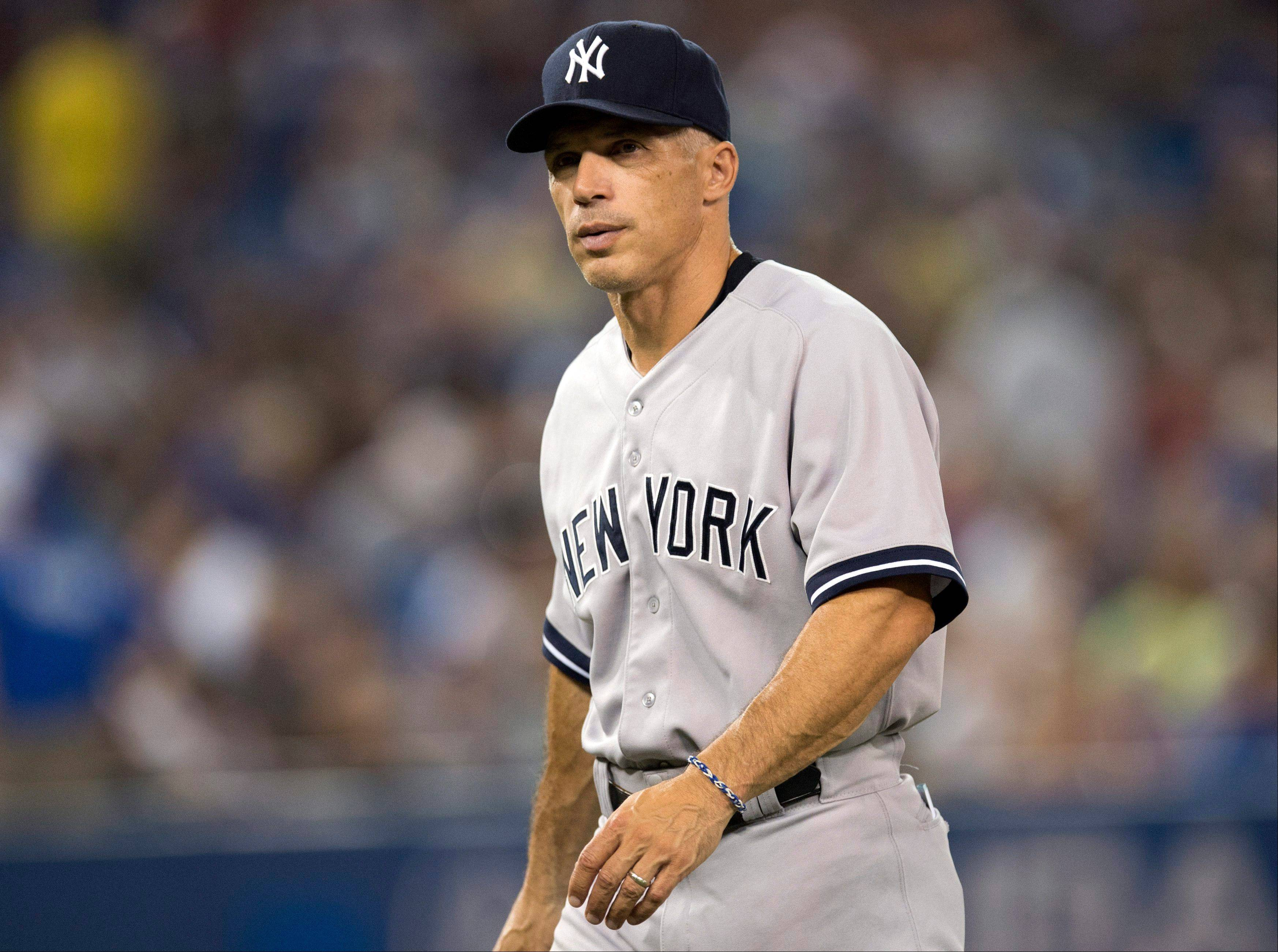 Although the Cubs wanted to talk with him, Joe Girardi has signed a four-year contract extension to stay with the New York Yankees as their manager.