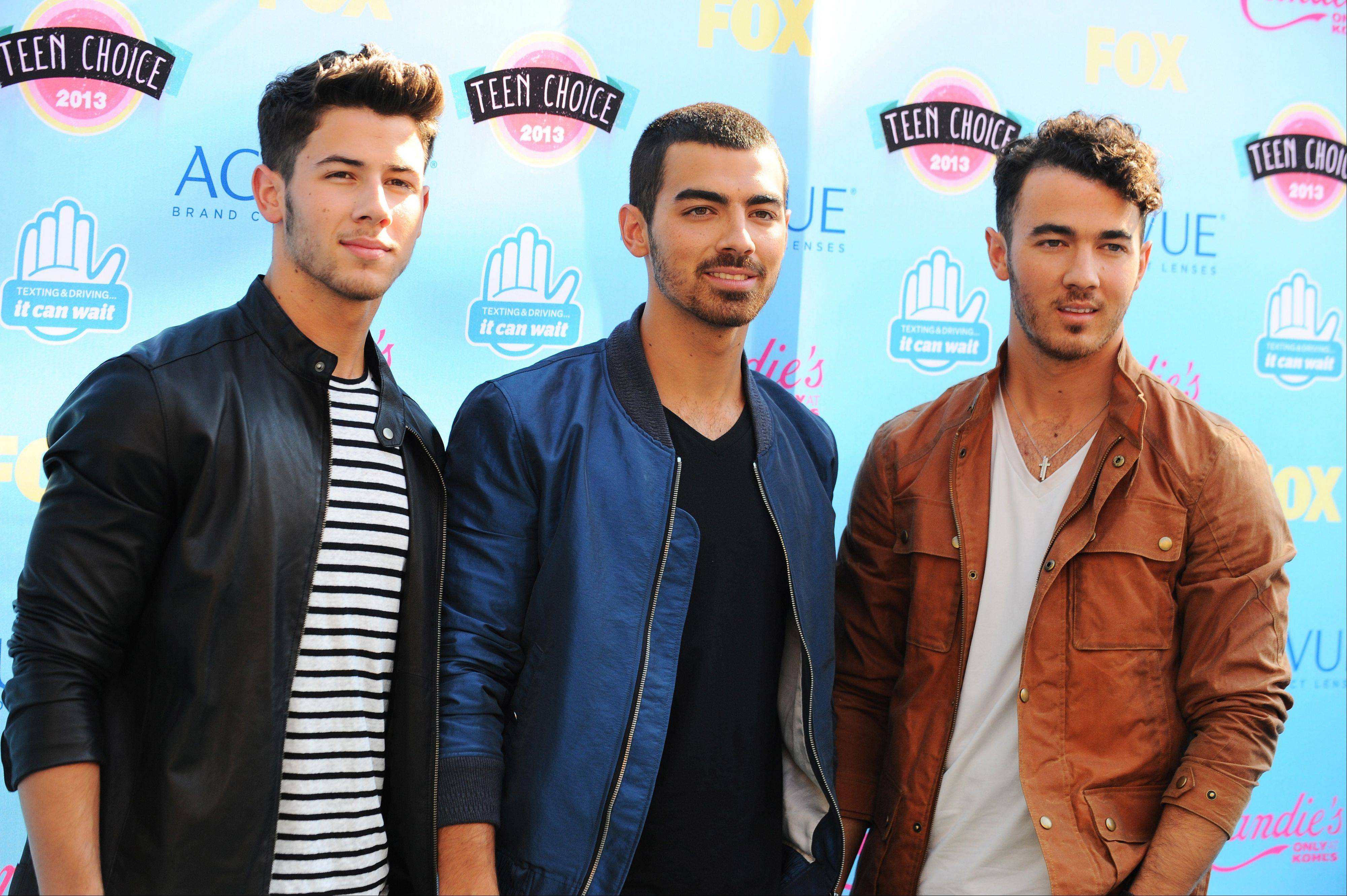 Nick Jonas, left, Joe Jonas and Kevin Jonas of the musical group Jonas Brothers are canceling their tour two days before it was supposed to begin.