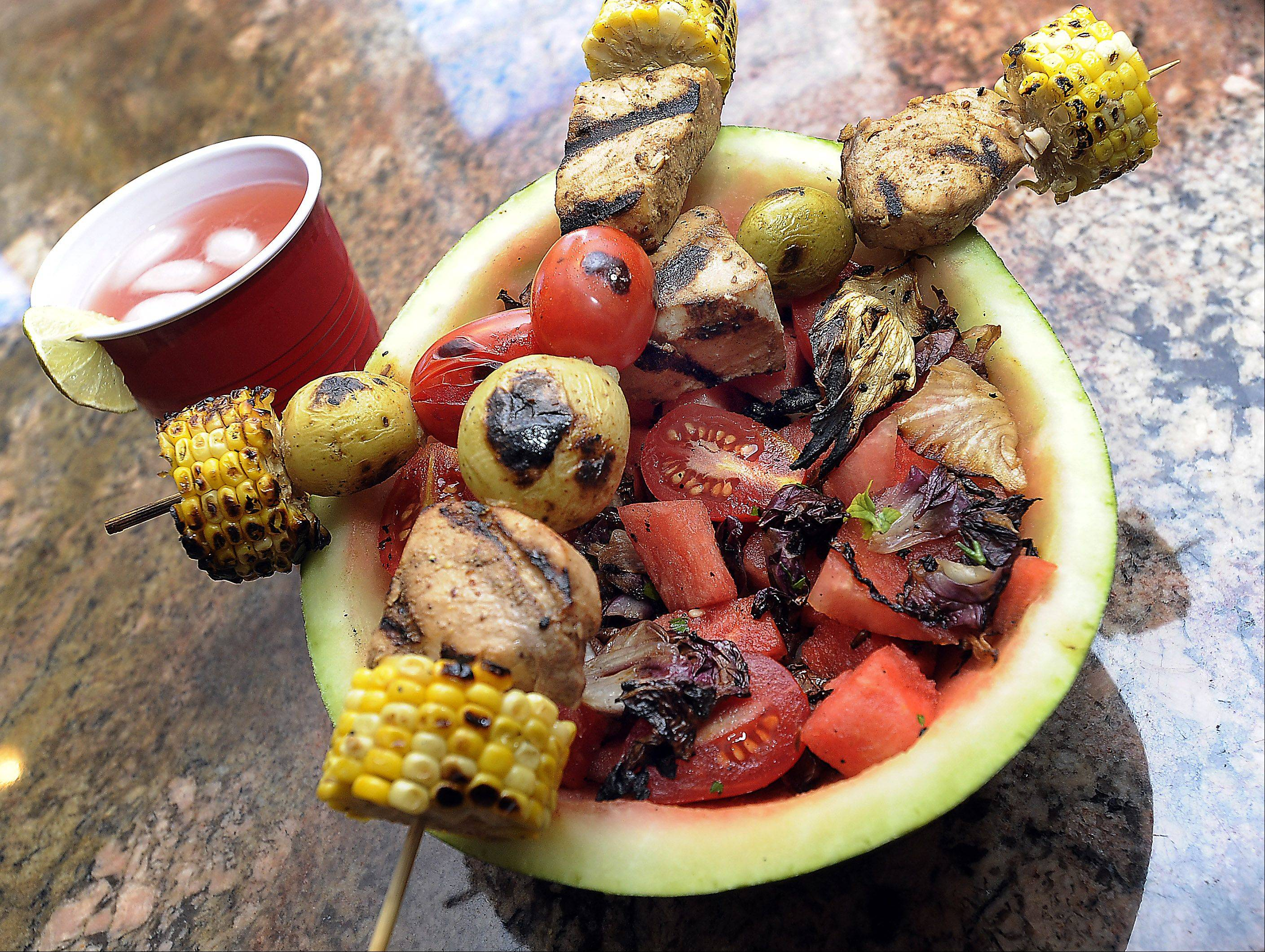 Tina Garrett serves her grilled radicchio salad and swordfish and corn kebabs in a watermelon bowl.