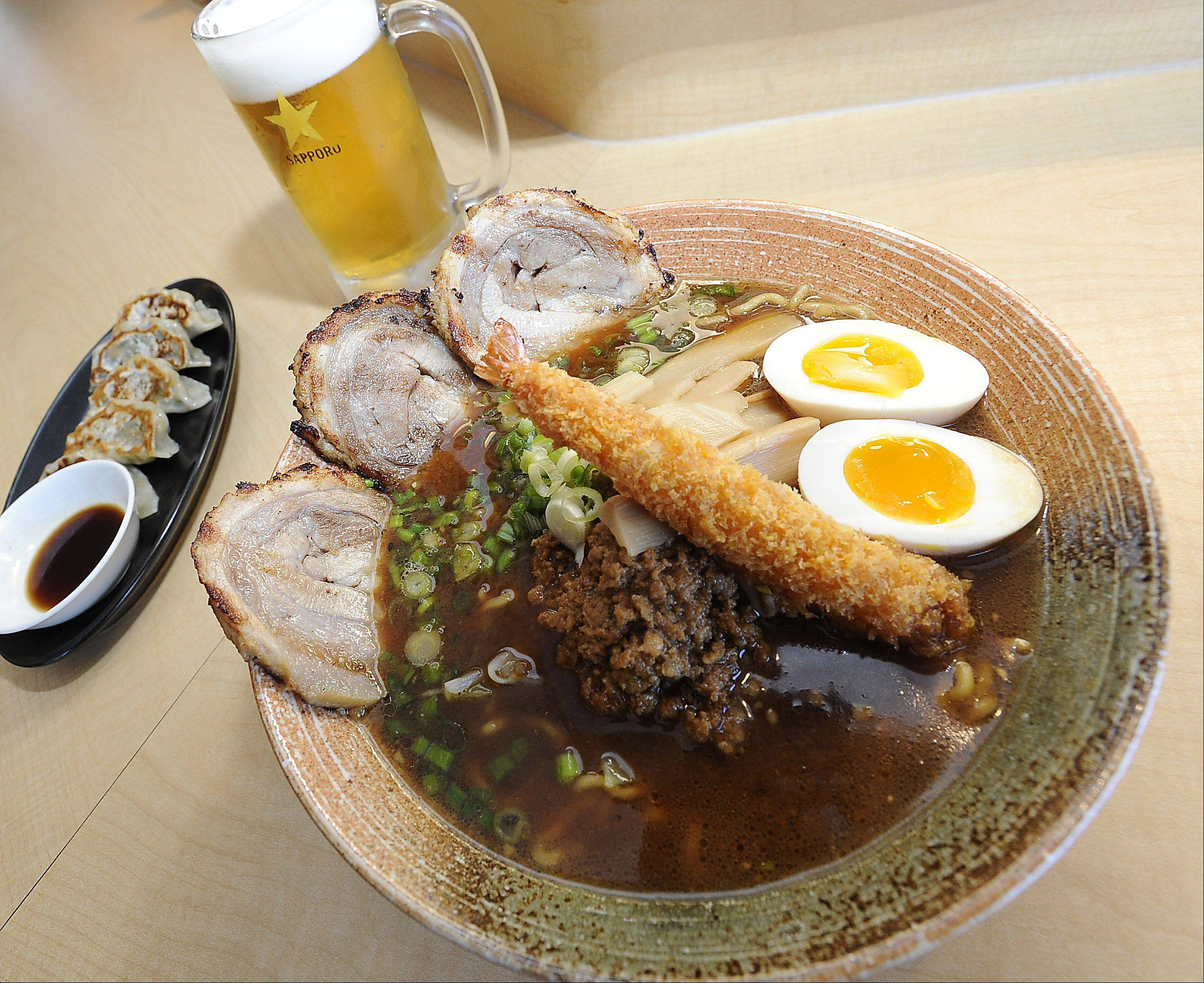 Mount Prospect's Ramen Misoya staple dish Nagoya-style mame miso with egg gyoza/dumplings and Sapporo to wash it all down.