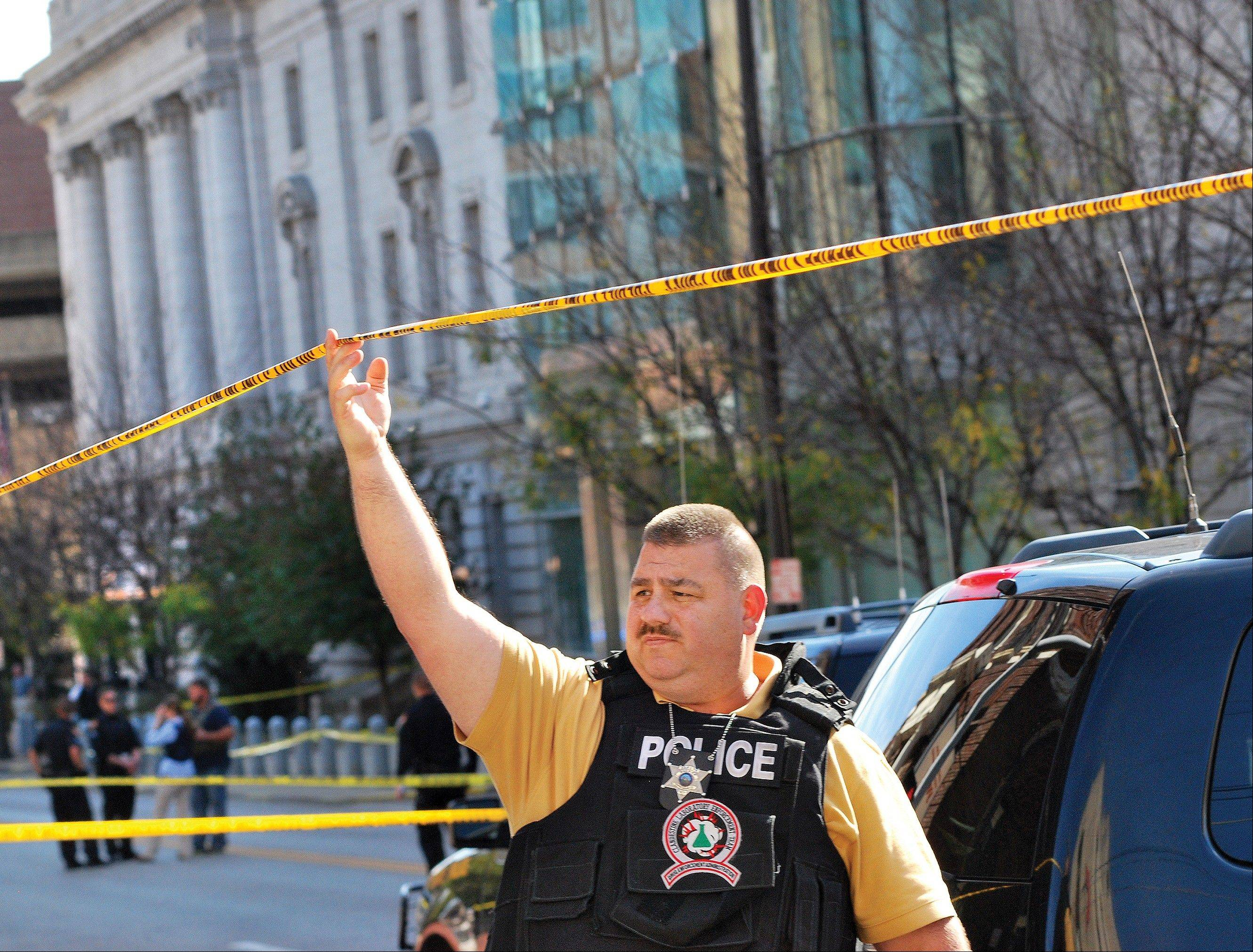 An Ohio County Sherriff Department deputy secures an area in front of the Federal Buildng in Wheeling, W. Va., Wedneday, following a shooting outside the courthouse.