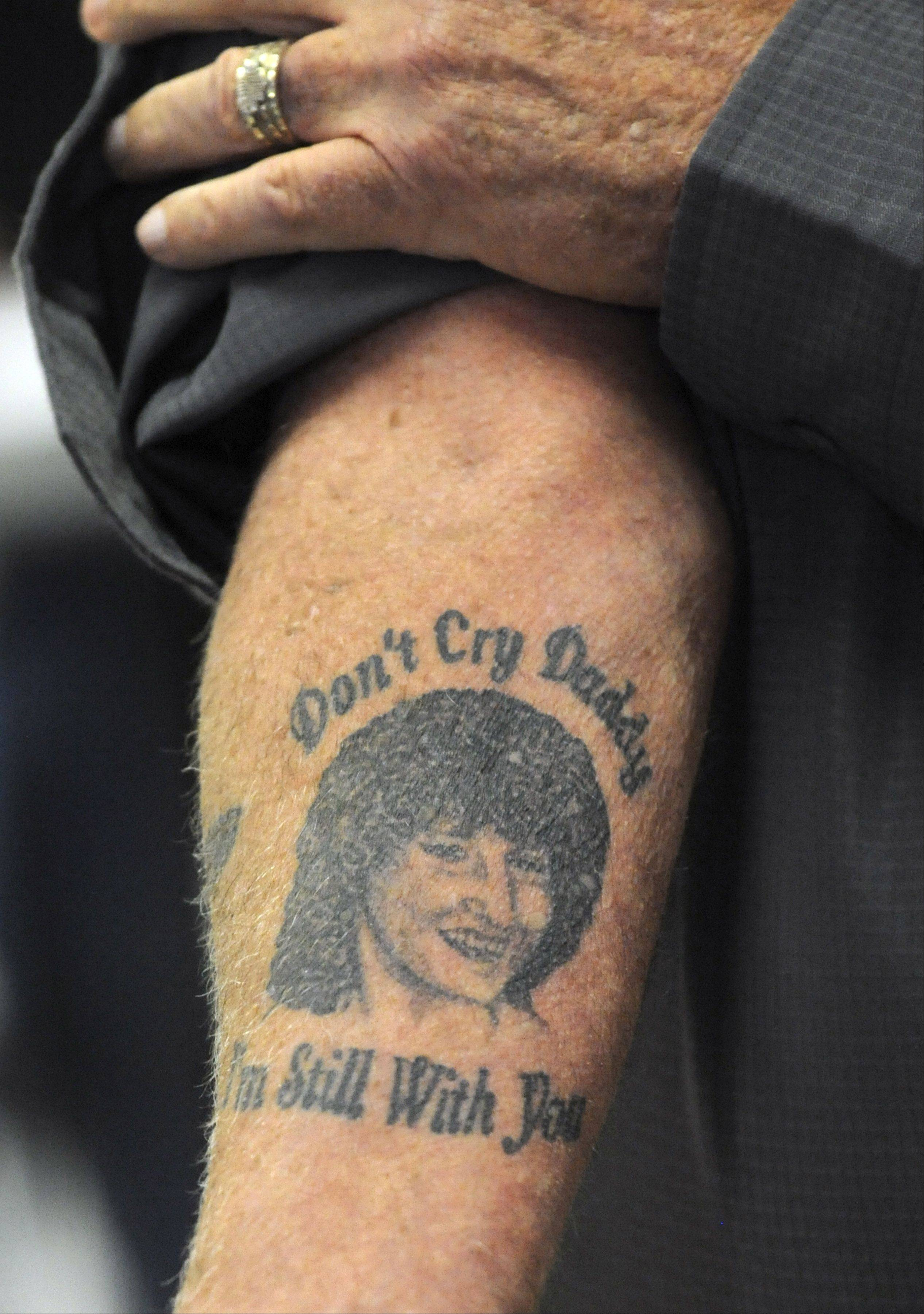 "Richard Dean, the father of Mary Hutchison, shows a tattoo of his daughter with the words that came to him in a dream ""Don't Cry Daddy, I'm Still With You."" Dean received the tattoo two months after his daughter's funeral. James Ealy, 49, of Lake Villa, was sentenced to natural life in prison for first-degree murder in the strangulation death of Mary Hutchison, of Trevor, Wis., at the Burger King in Lindenhurst on Nov. 27, 2006."