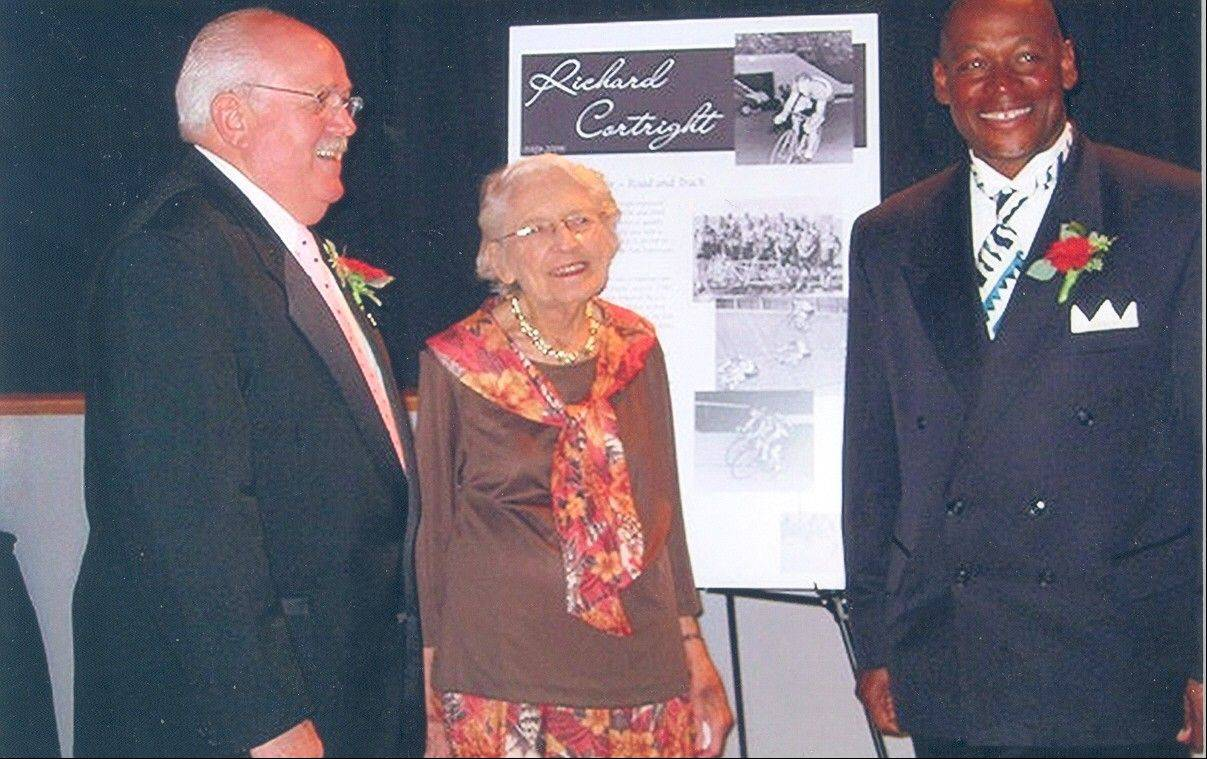 Phyllis Harmon poses with other 2009 inductees in the U.S. Bicycling Hall of Fame: Clayton John, left, and Nelson Vails.