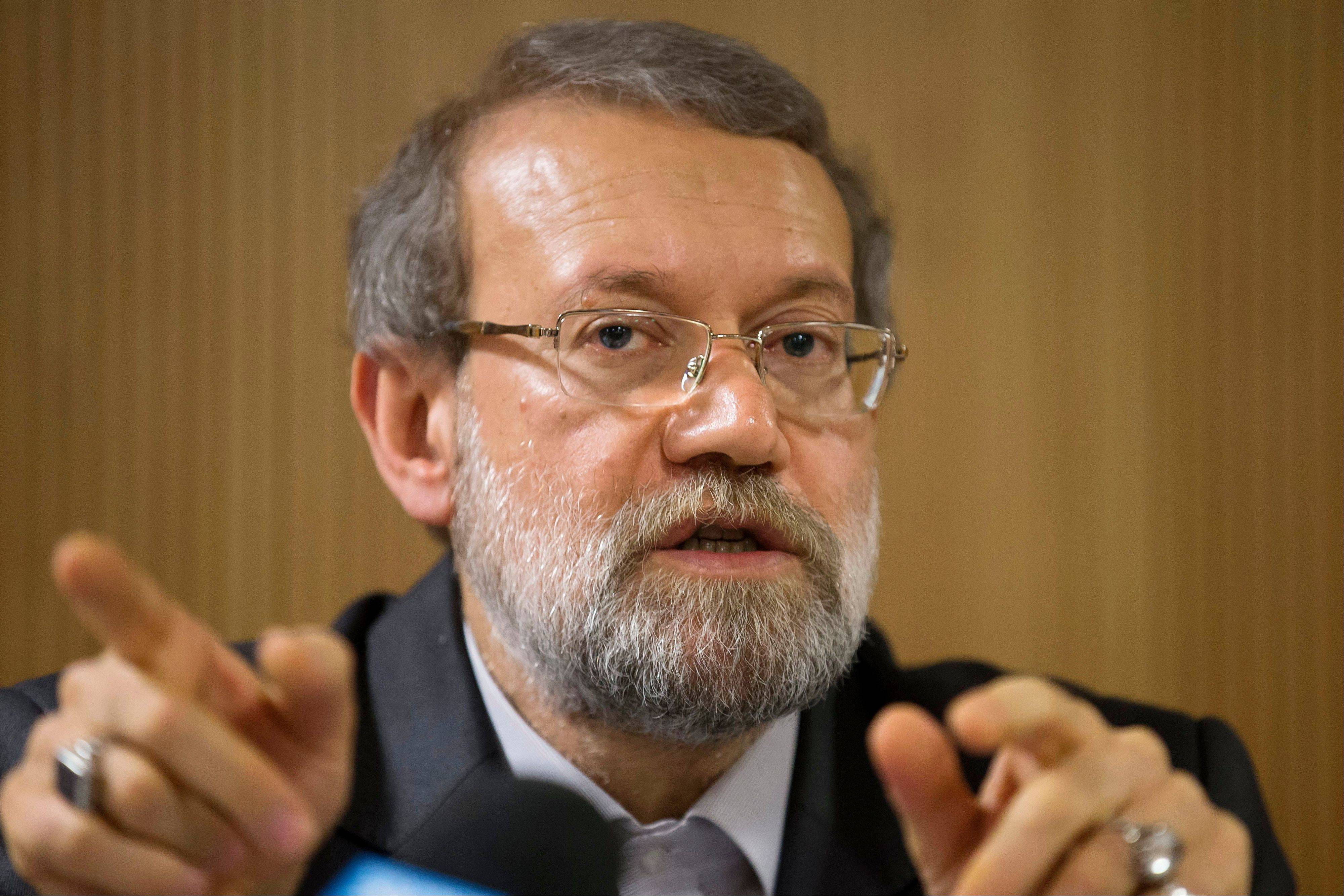 Iran's Parliament speaker Ali Larijani answers a question during a press conference on the sidelines of the 129th Assembly of the Inter-Parliamentary Union (IPU), in Geneva, Switzerland, Wednesday, Oct. 9, 2013. In an Associated Press interview, Larijani saidIran has more enriched uranium than it needs and plans to use that as a bargaining chip at nuclear talks in Geneva next week.