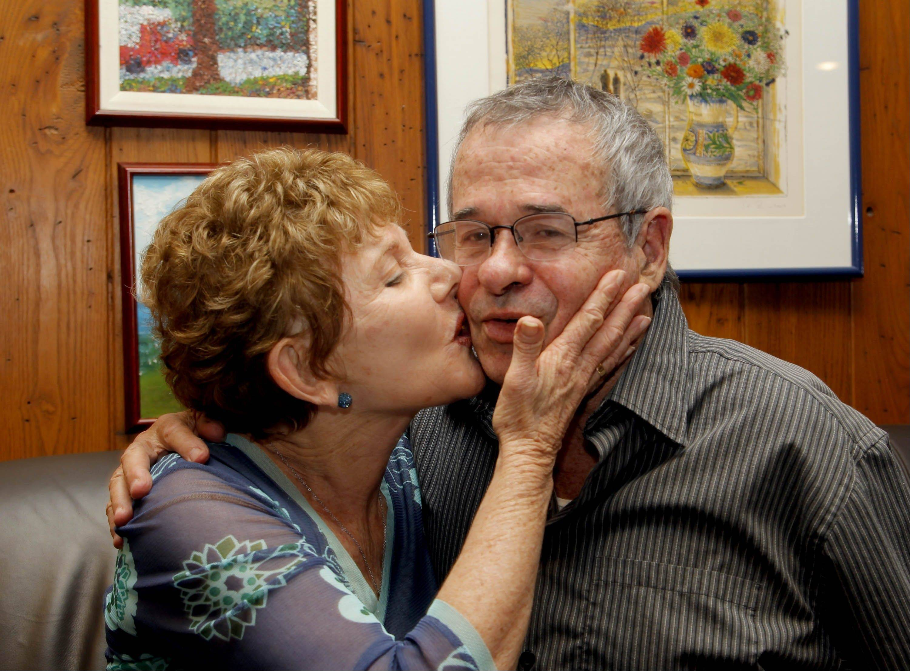 Tami Warshel kisses her husband, University of Southern California Professor of Chemistry and Biochemistry, Arieh Warshel, at his home in Los Angeles, after he was awarded the Nobel Prize in Chemistry on Wednesday.