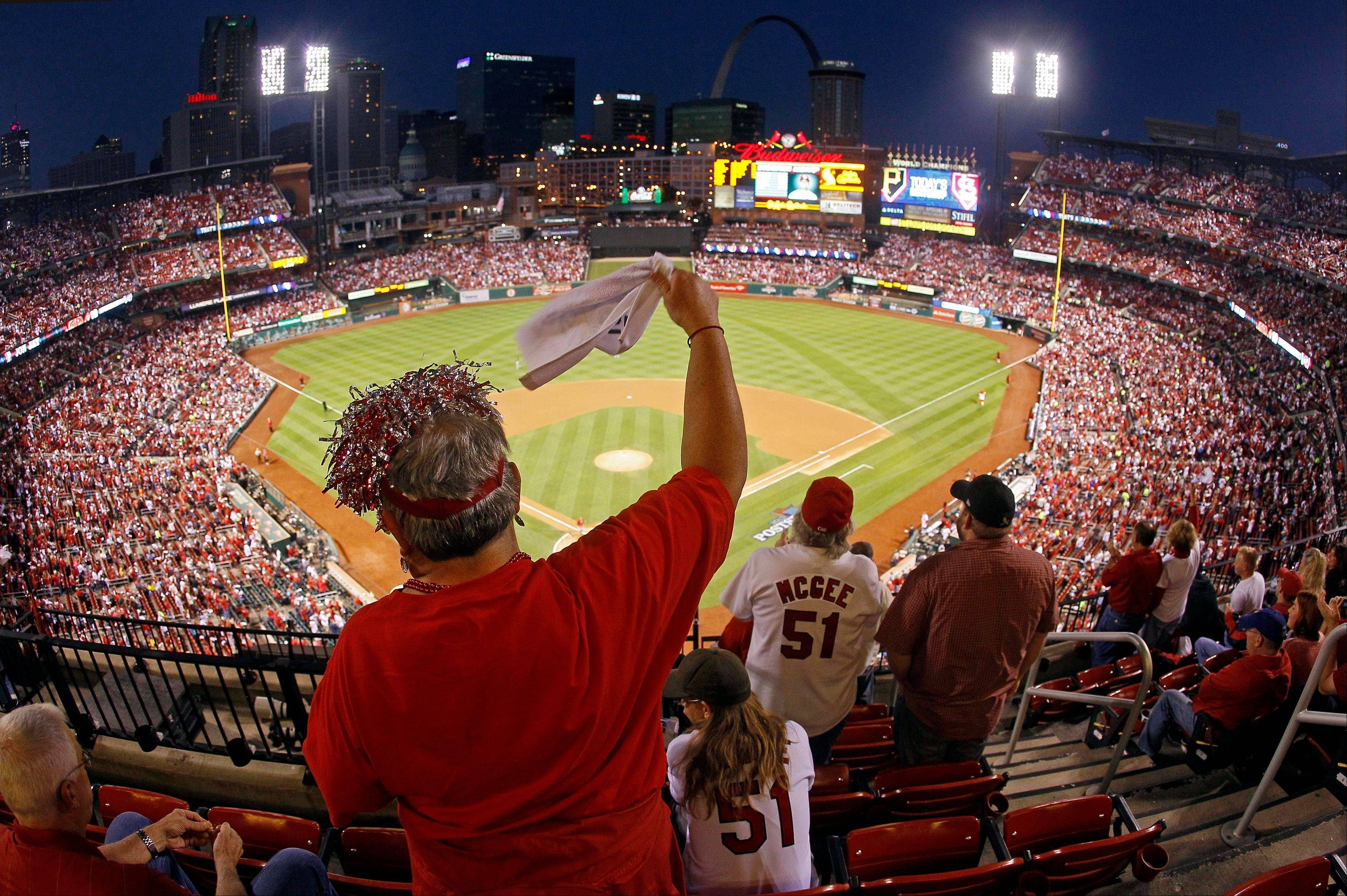 Cardinals fan Dawn Schallenberg of Bethalto, Ill., cheers as the players are introduced before Game 5 of the National League Division Series against the Pittsburgh Pirates on Wednesday in St. Louis.