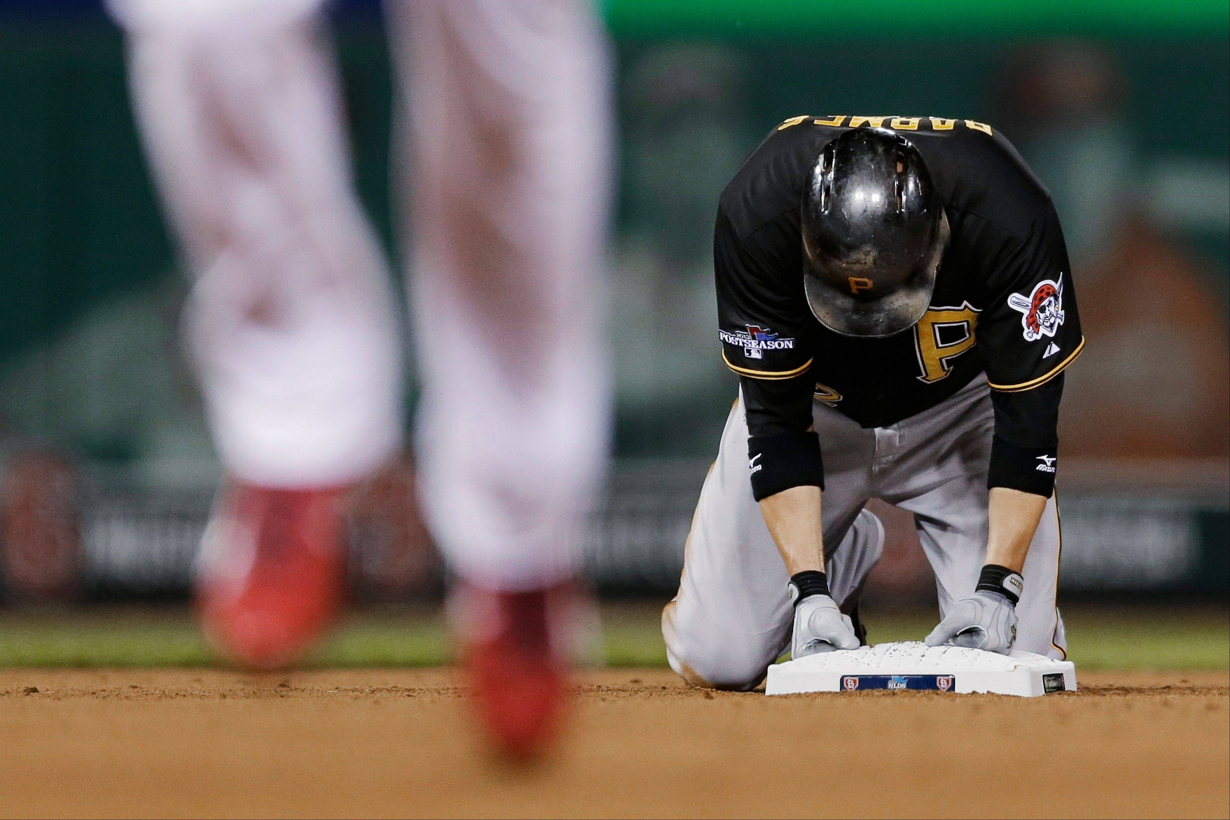 Pittsburgh's Clint Barmes kneels on second base after being forced out on a double play in the sixth inning.