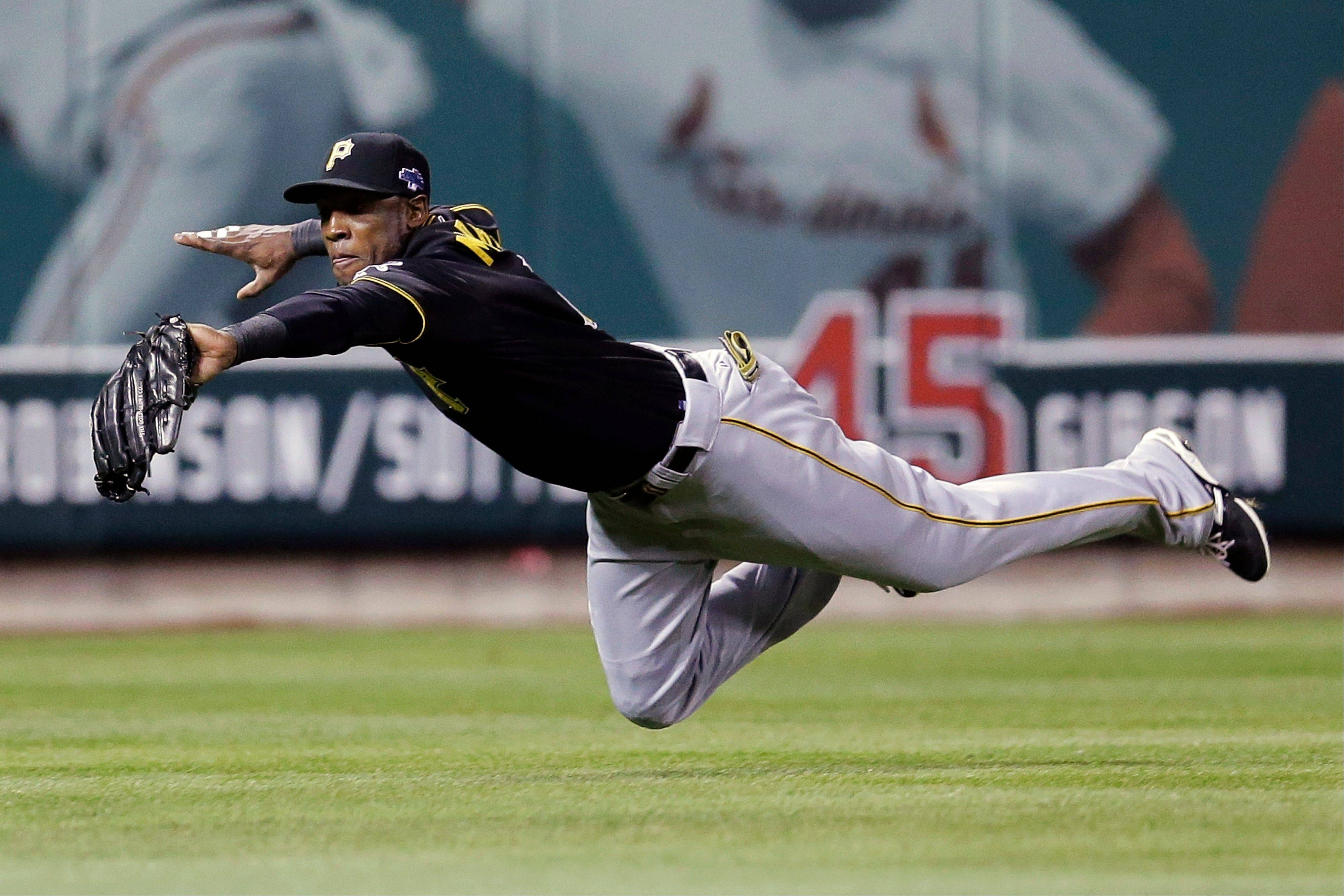 Pirates left fielder Starling Marte makes a diving catch on a ball hit by the Cardinals' Matt Carpenter in the third inning.