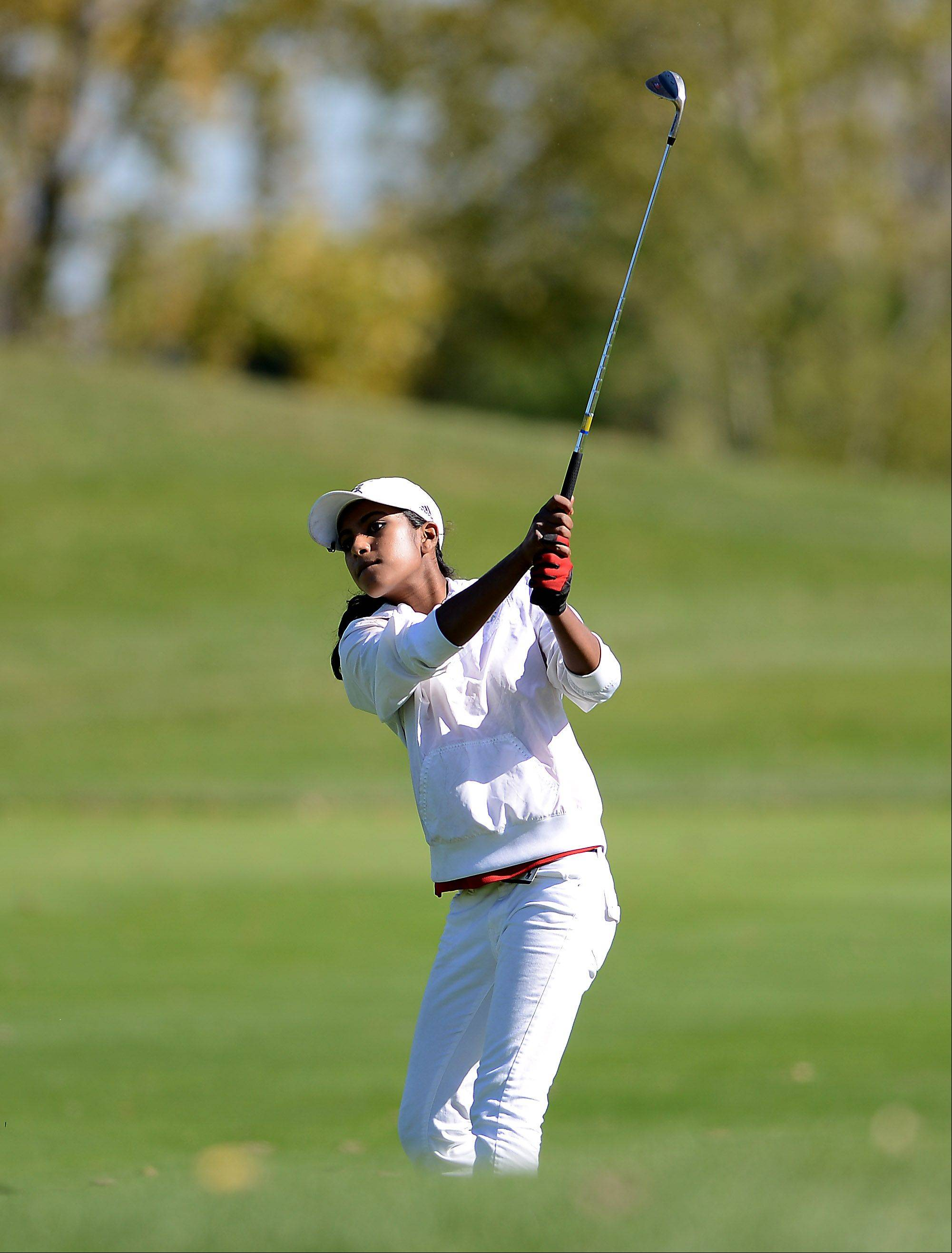Barrington's Reena Sulkar hits from the fairway during Wednesday's Prairie Ridge regional golf action at Prairie Isle golf course in Crystal Lake