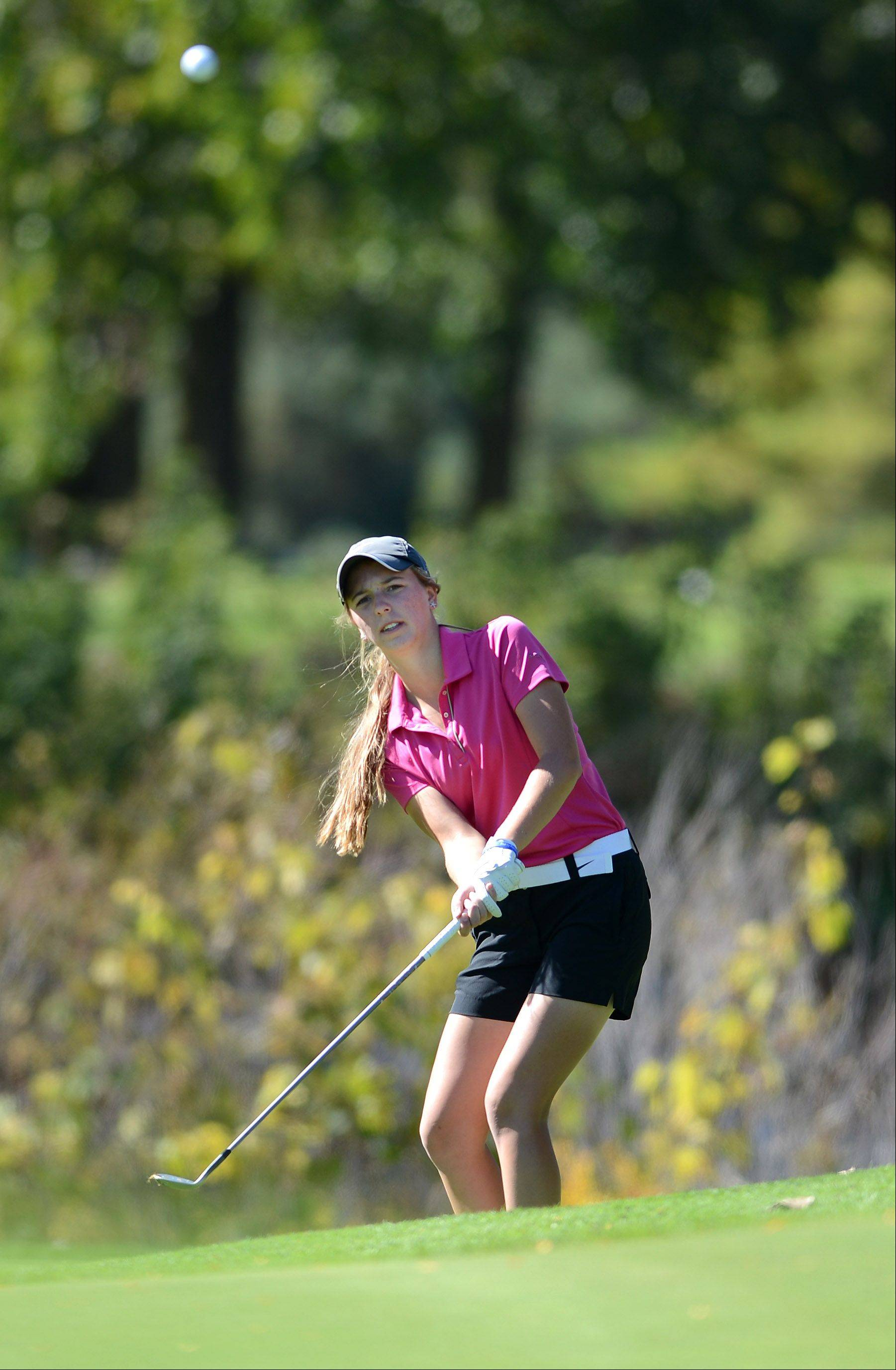 Bailey Bostler of Crystal Lake South (and the Crystal Lake Central co-op team) chips on to the 5th green during Wednesday's Prairie Ridge regional golf action at Prairie Isle golf course in Crystal Lake