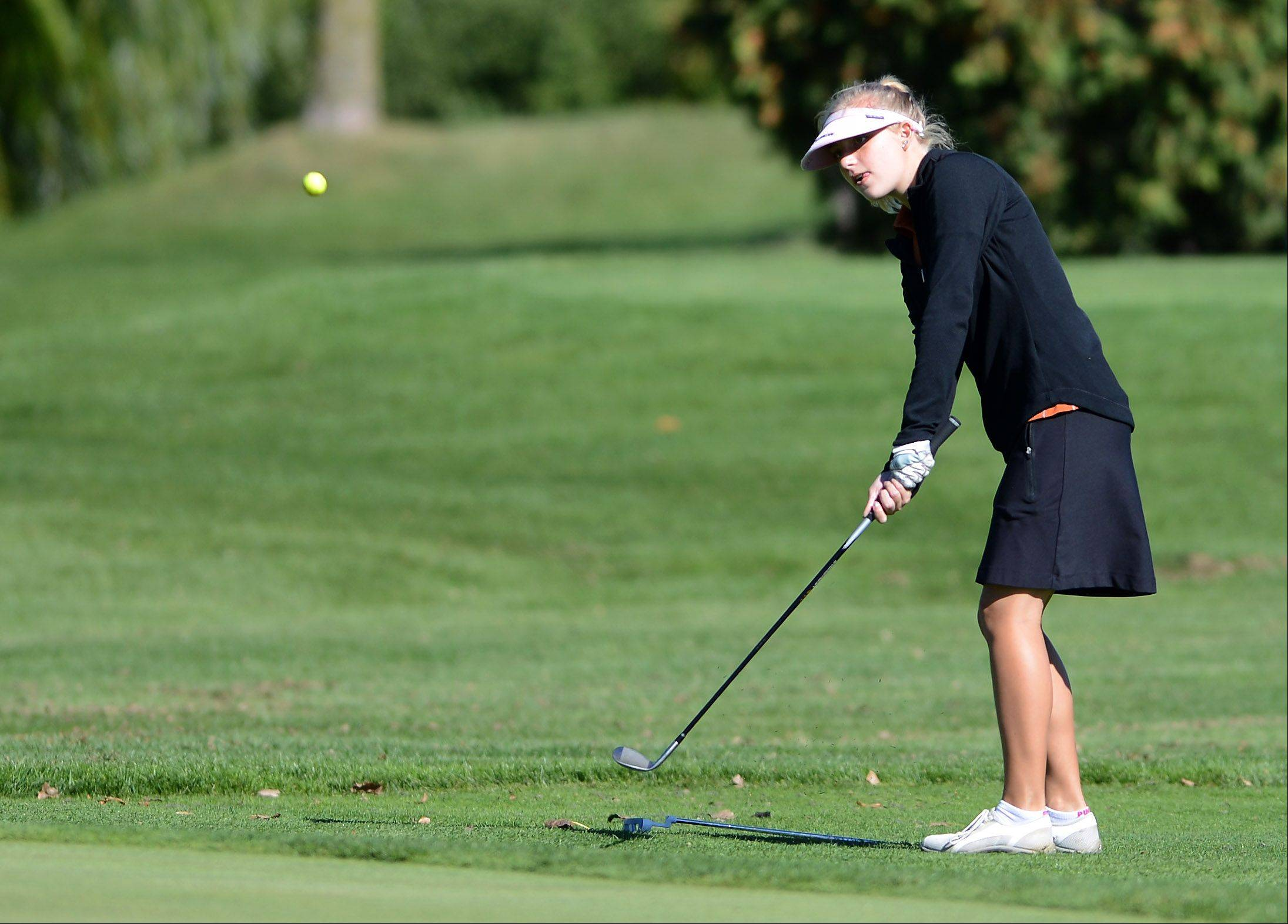 St. Charles East's Reagan Stanton chips on to the green during Wednesday's Prairie Ridge regional golf action at Prairie Isle golf course in Crystal Lake