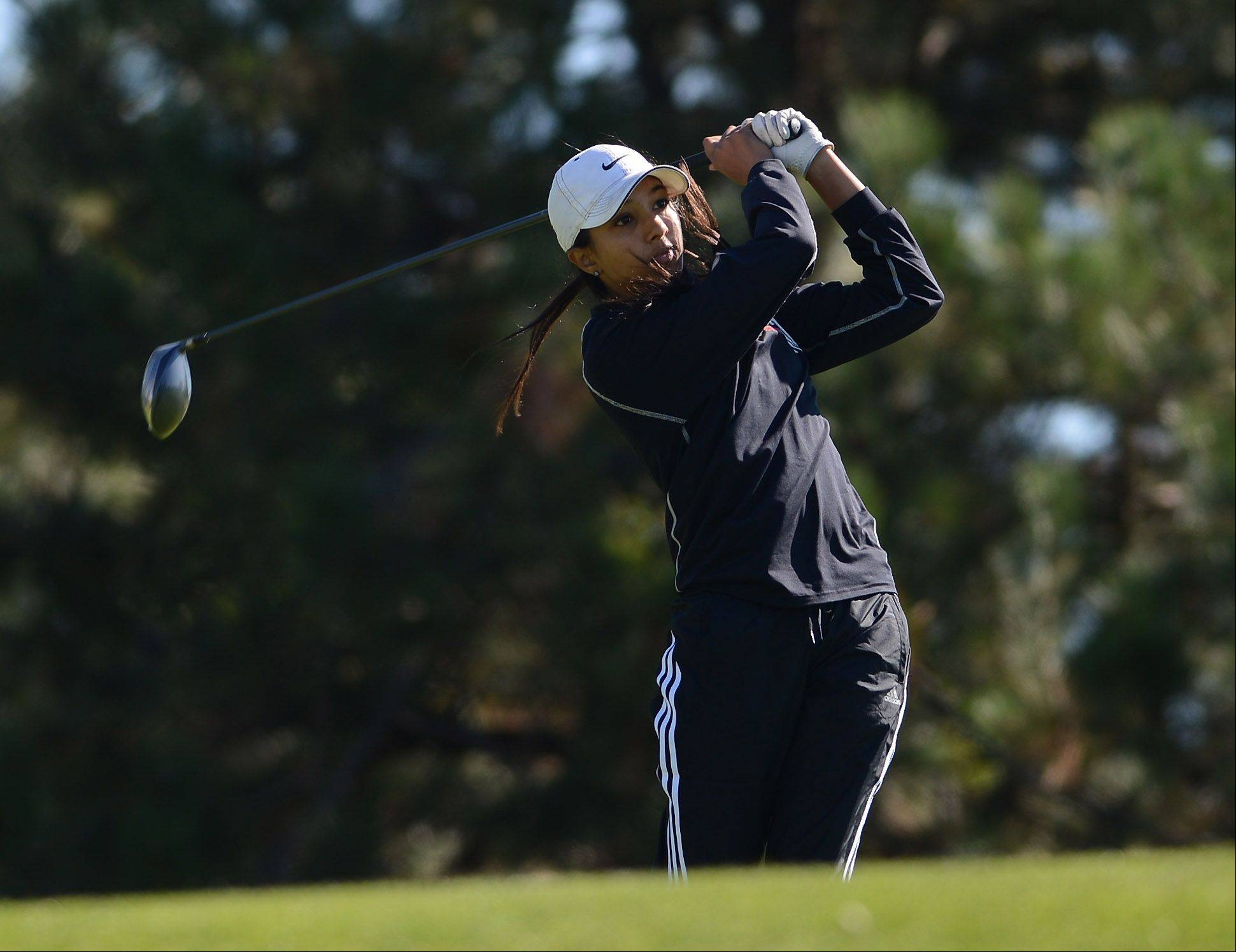 Barrington's Shivani Majmudar tees off during Wednesday's Prairie Ridge regional golf action at Prairie Isle golf course in Crystal Lake