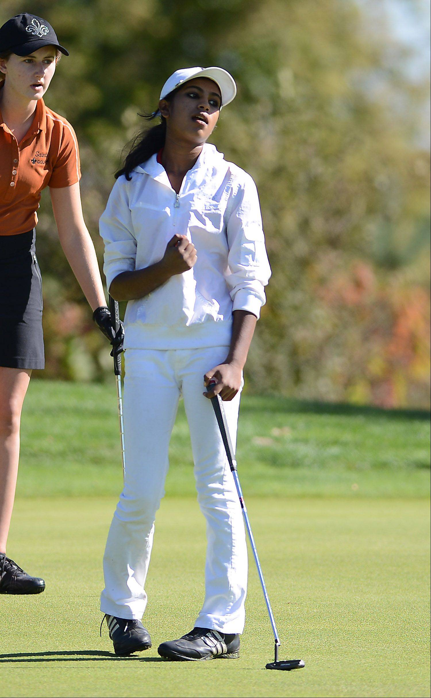 Barrington's Reena Sulkar pumps her fist after draining a 30ish foot putt on the first hole during Wednesday's Prairie Ridge regional golf action at Prairie Isle golf course in Crystal Lake
