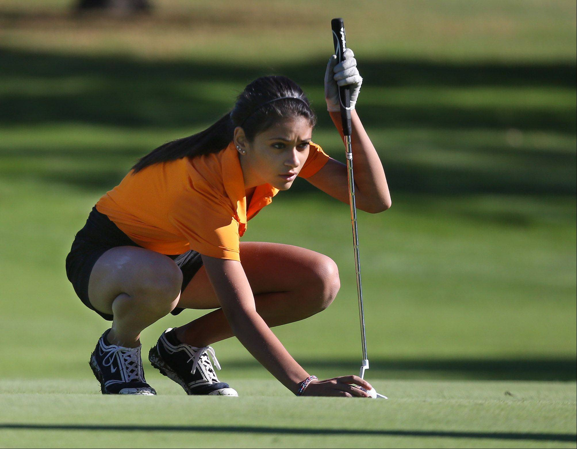 Libertyville golfer Simone Mikaelian lines up her putt on the first hole during the Class AA Carmel girls golf regional Wednesday at Bonnie Brook.