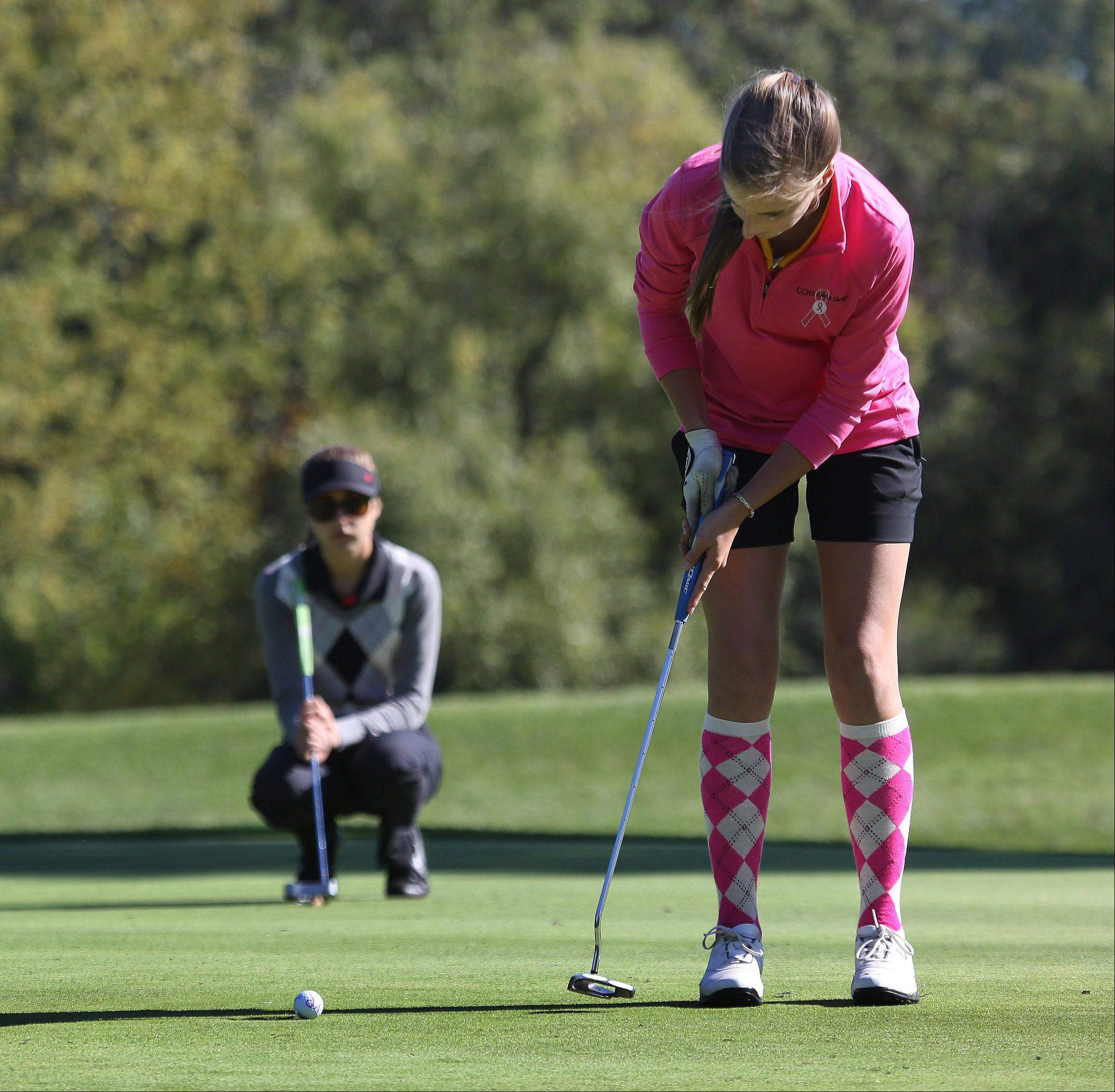 Carmel Catholic golfer Kayla Ryan putts on the second hole during the Class AA Carmel girls golf regional Wednesday at Bonnie Brook.