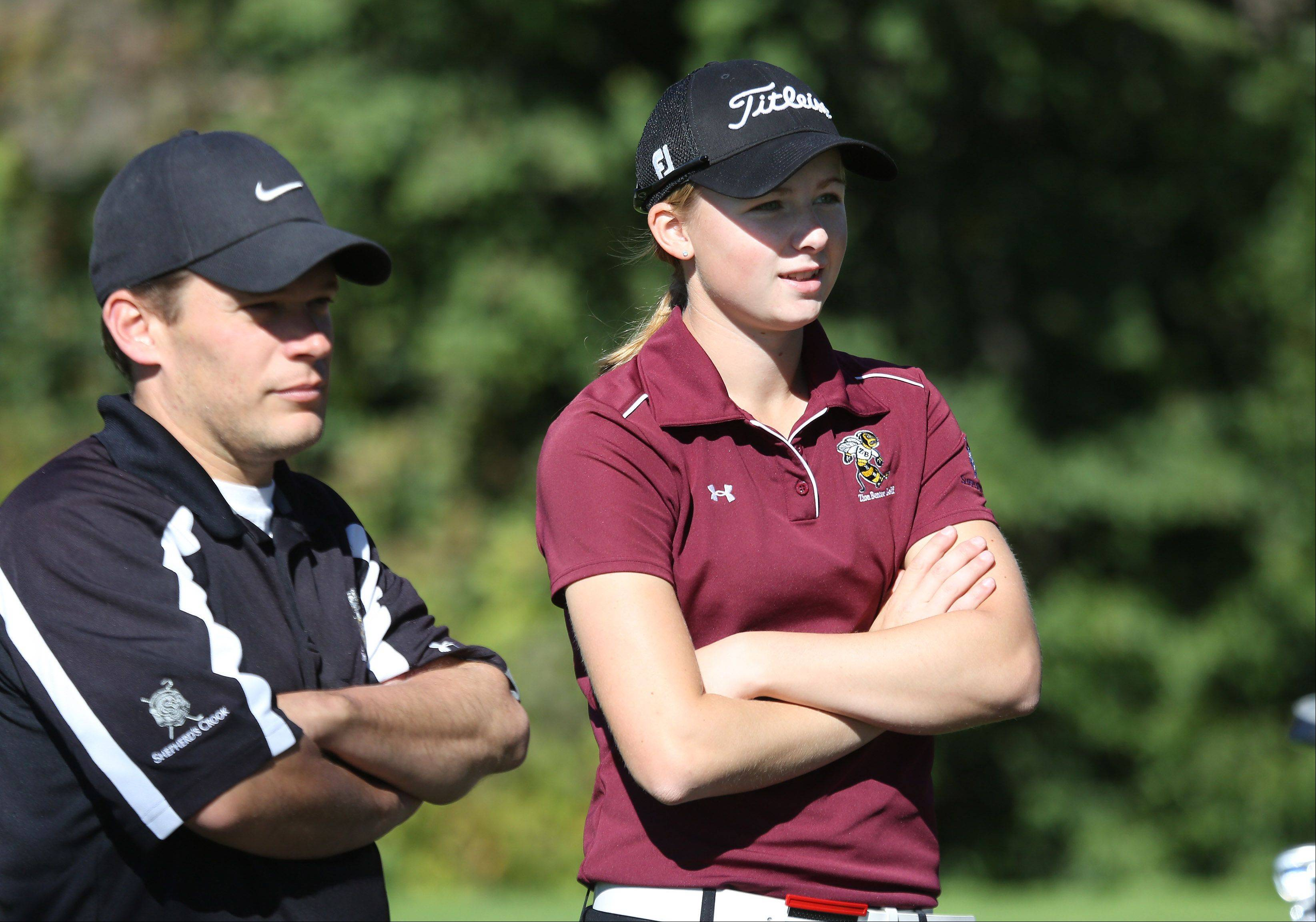 Zion-Benton golfer Morgan Kukla talks to her coach during the Class AA Carmel girls golf regional tournament Wednesday at Bonnie Brook.