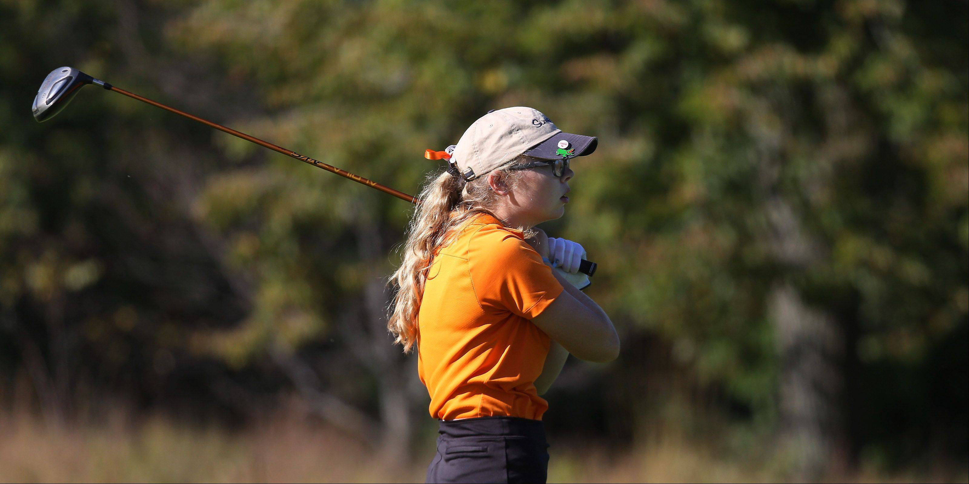 Libertyville golfer Emma Hoskins watches her tee off shot on the second hole during the Class AA Carmel girls golf regional Wednesday at Bonnie Brook.