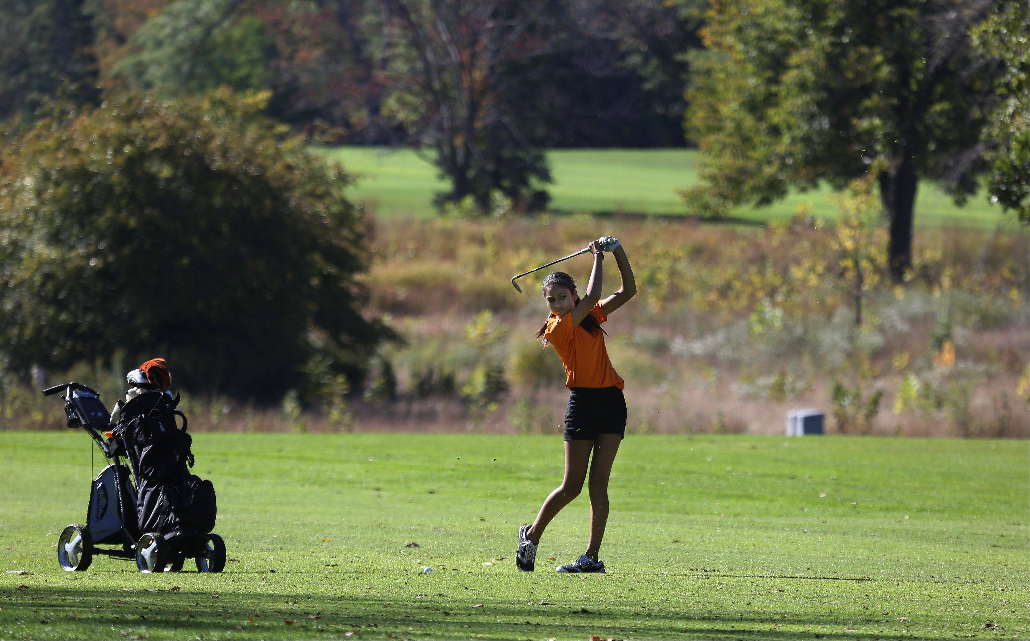 Libertyville golfer Simone Mikaelian hits an approach shot on the first hole during the Class AA Carmel girls golf regional Wednesday at Bonnie Brook.