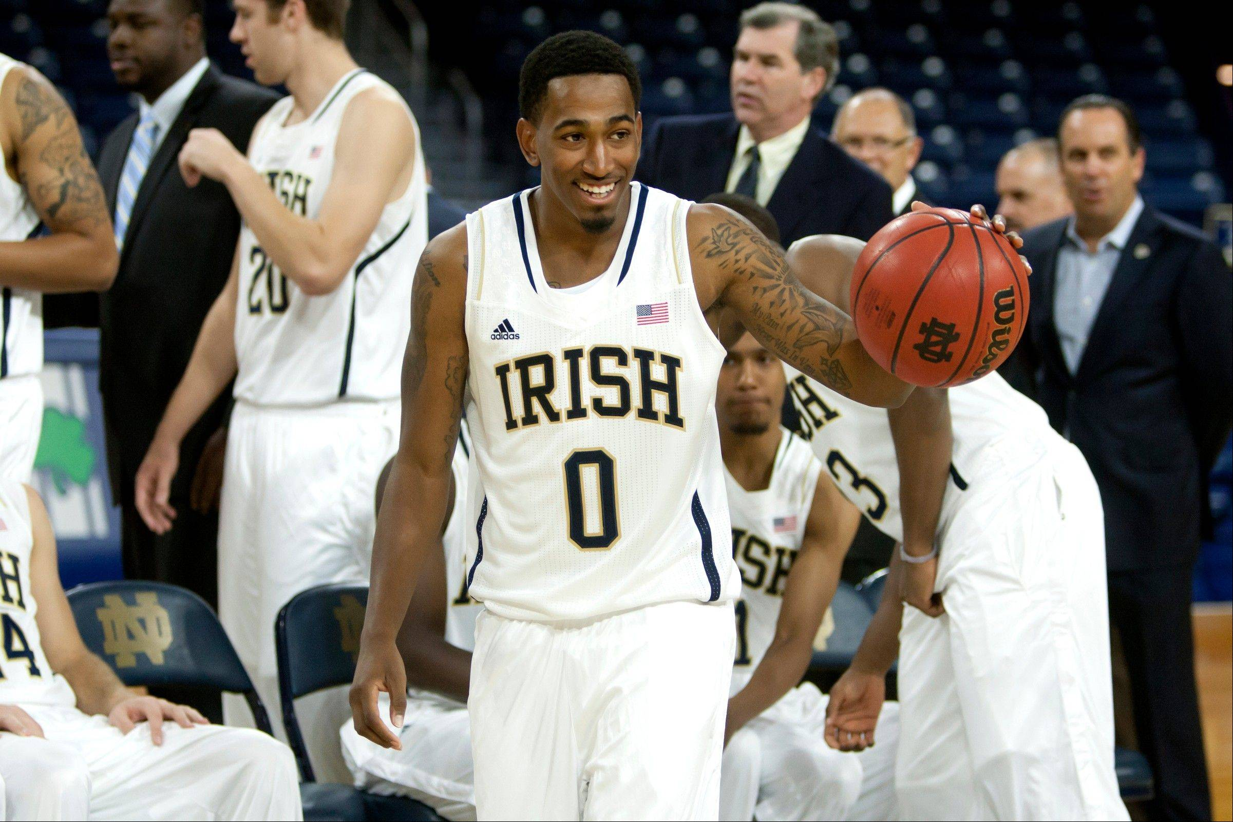 Notre Dame guard Eric Atkins dribbles after an official photograph during the team's media day on Wednesday in South Bend, Ind.