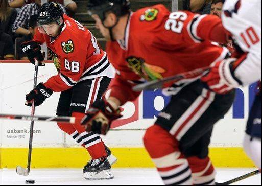 Chicago Blackhawks' Patrick Kane (88) controls the puck during the second period of an NHL preseason hockey game against the Washington Capitals in Chicago, Saturday, Sept. 28, 2013.