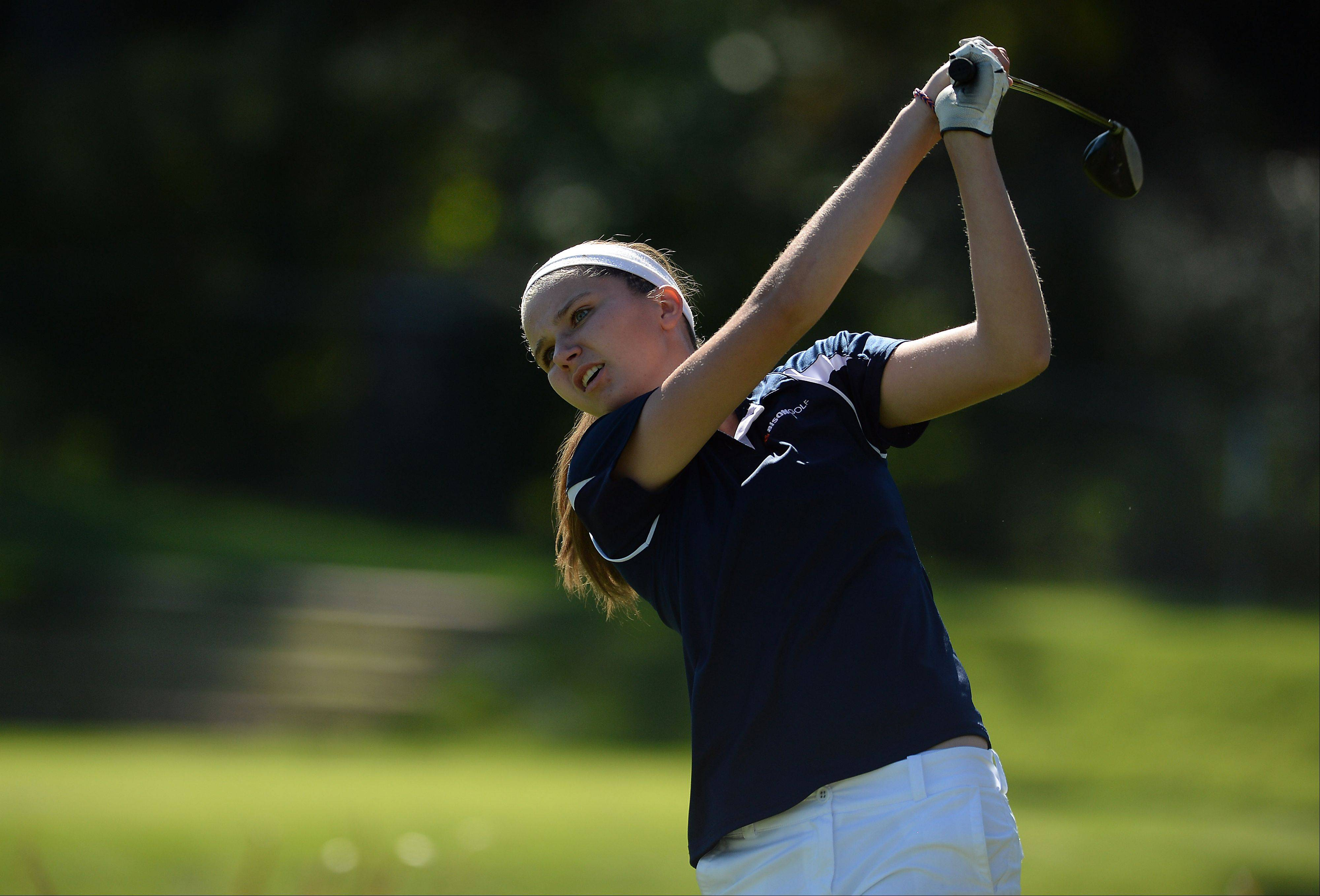Courtney Meyer of Buffalo Grove High School drives her ball down the fairway on the fourth hole in the girls golf regional at Mt. Prospect Golf Club on Wednesday.