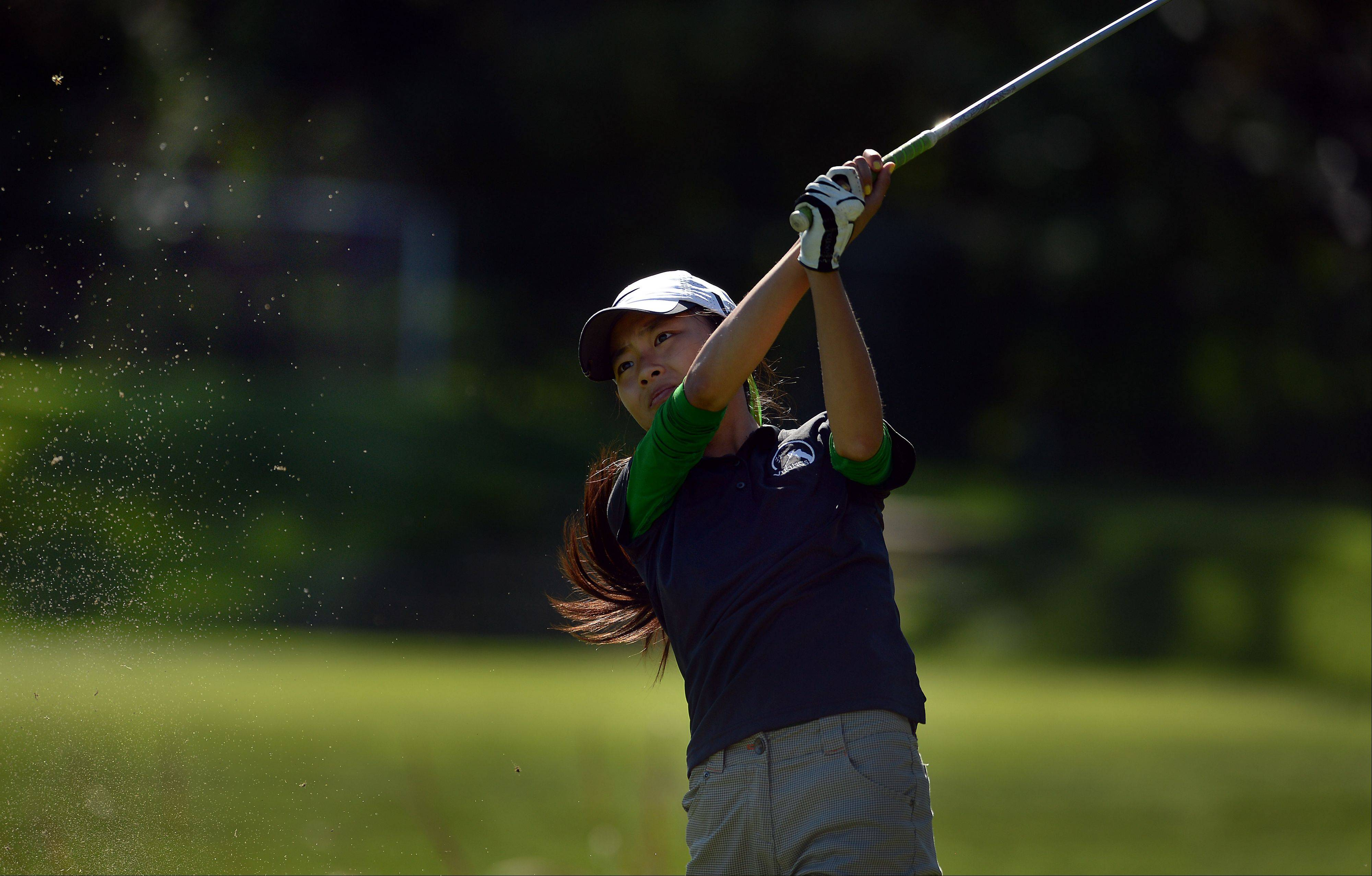 Haezi Jung of Fremd chips on No. 4 in the girls golf regional contest at Mt. Prospect Golf Club on Wednesday.