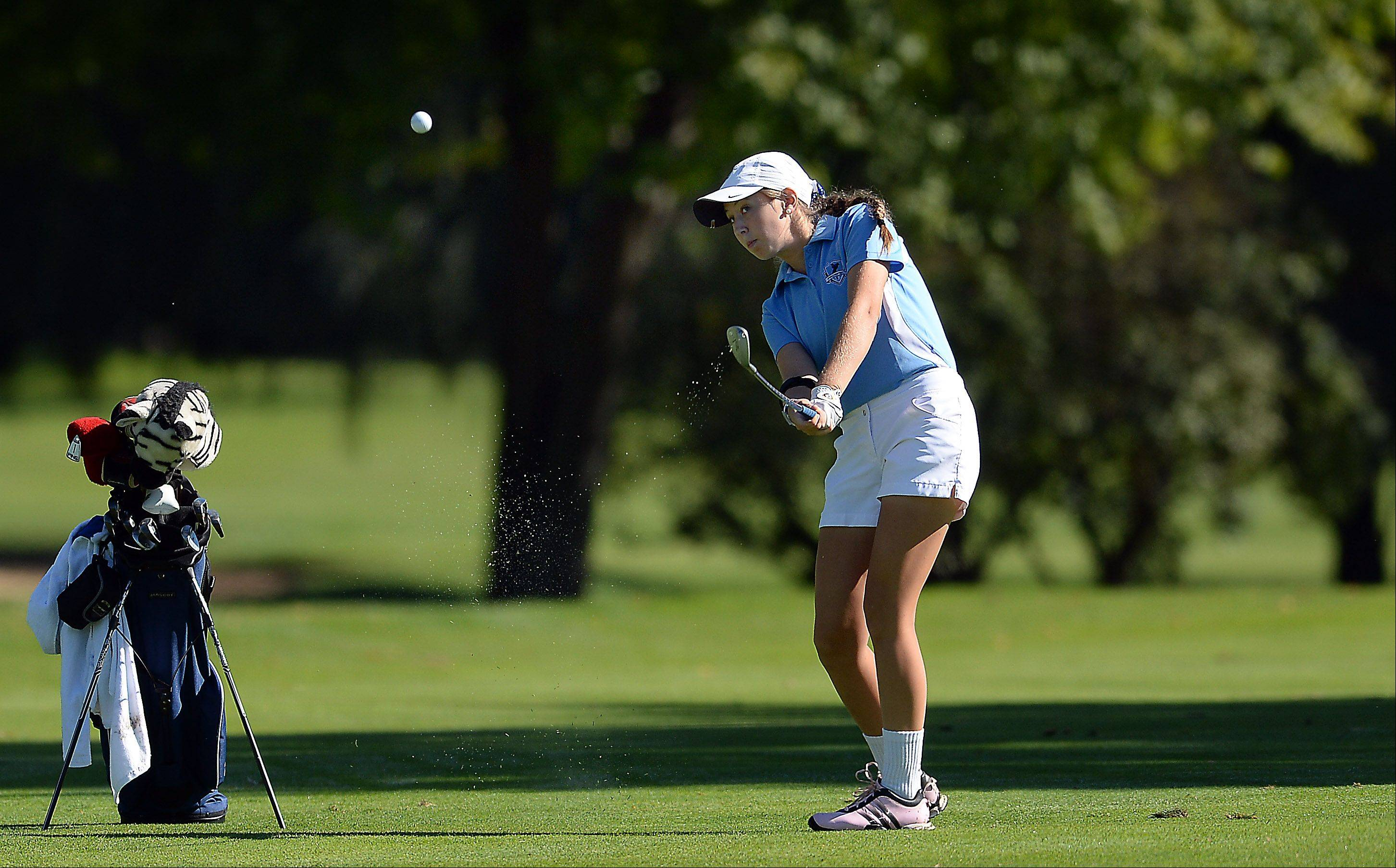 Prospect's Kiley Walsh chips up her shot on the green on hole three at the girls varsity golf regional at Mt. Prospect Golf Club on Wednesday.