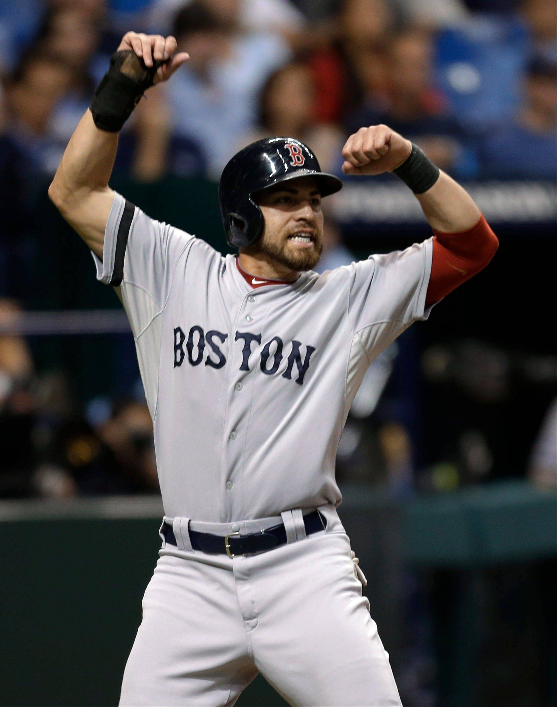 Red Sox center fielder Jacoby Ellsbury reacts as he scores on a single by Shane Victorino in the seventh inning Tuesday in Game 4 of an American League Division Series against the Tampa Bay Rays in St. Petersburg, Fla.