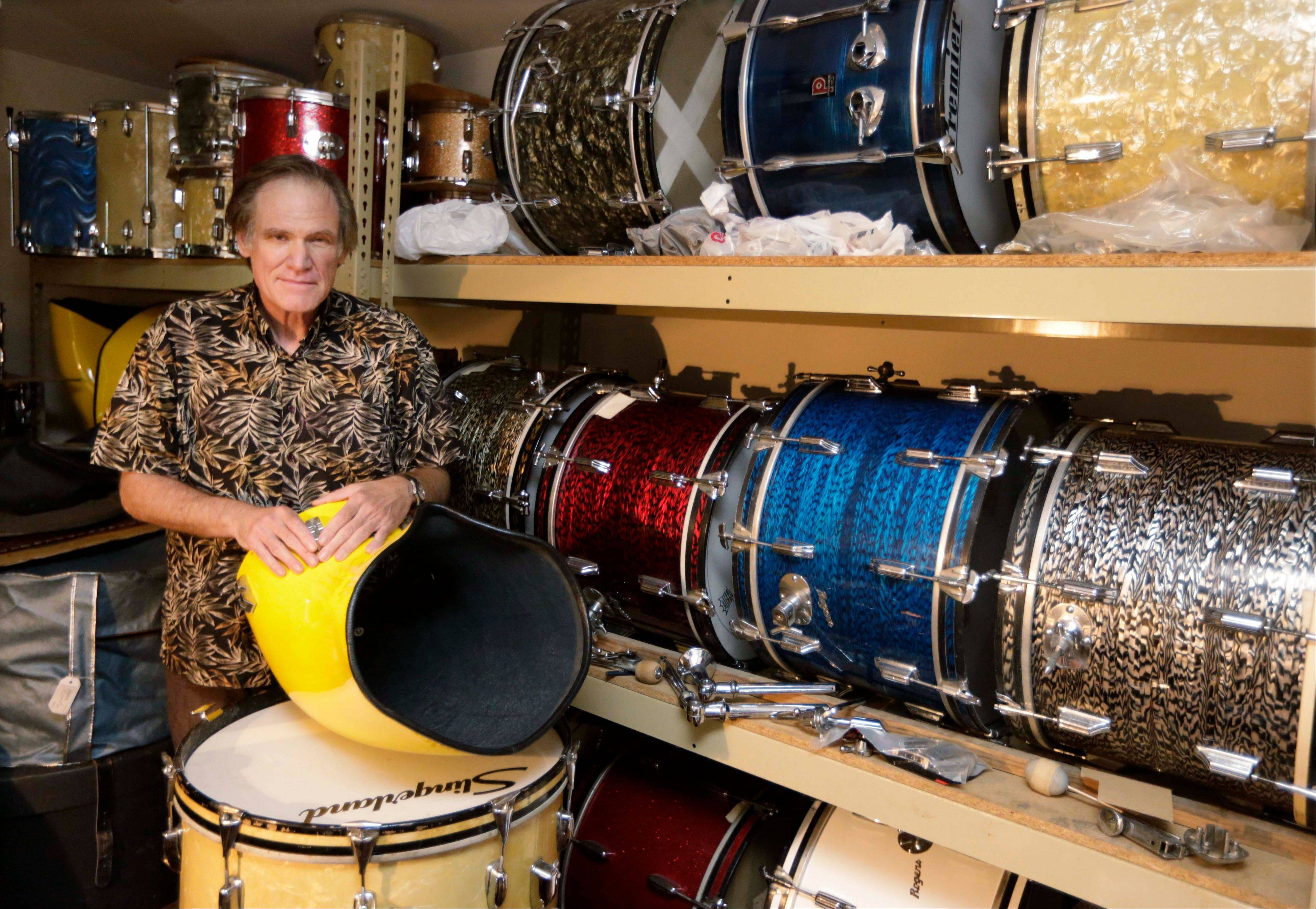 James Glay poses with his collection of vintage drums in Arlington Heights. Every passing month and unanswered resume dimmed Glay's optimism more. With no job in sight, he joined a growing number of older people and created his own.