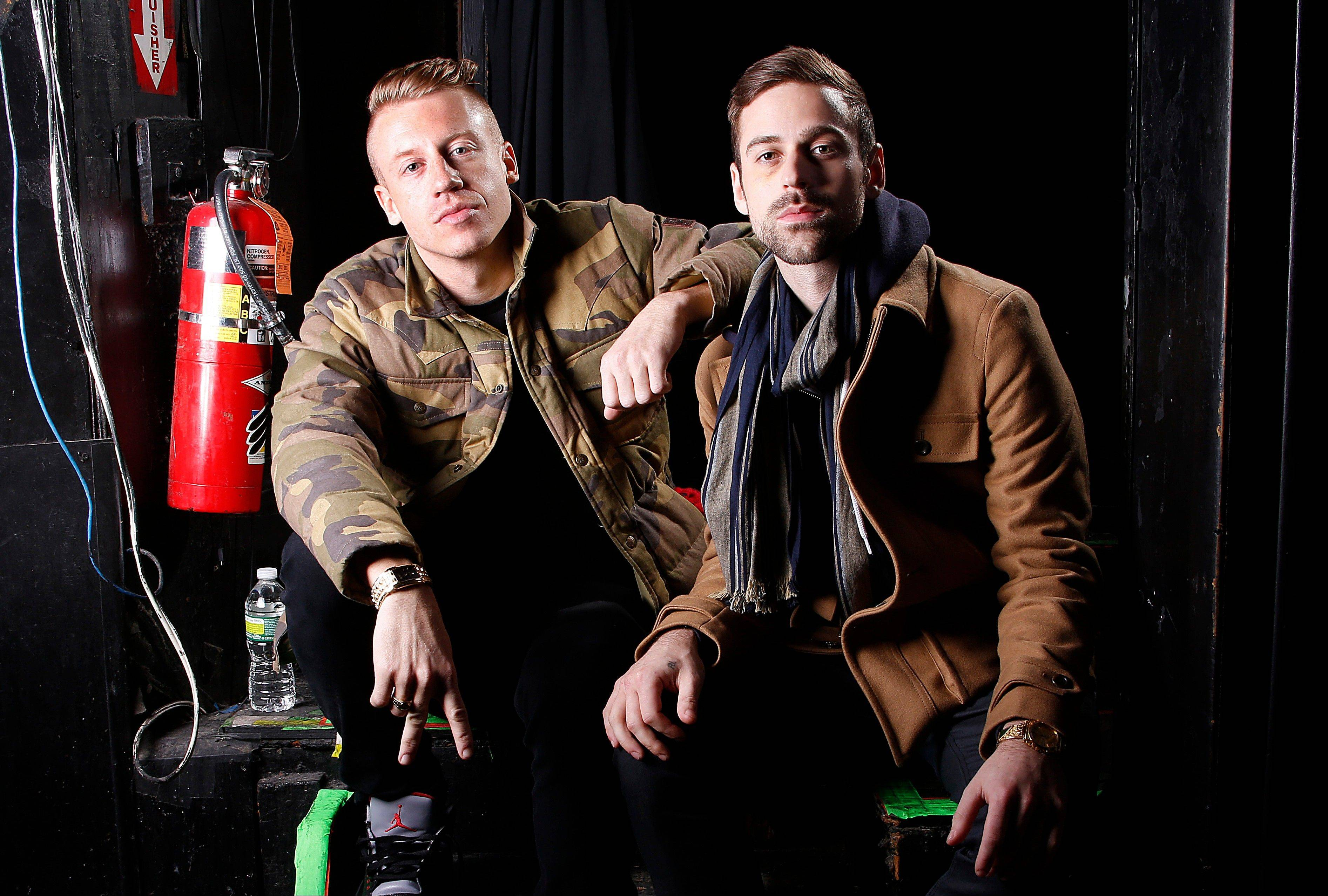 Newcomers Macklemore & Ryan Lewis will battle heavyweights Justin Timberlake and Taylor Swift for the top prize at the 2013 American Music Awards.