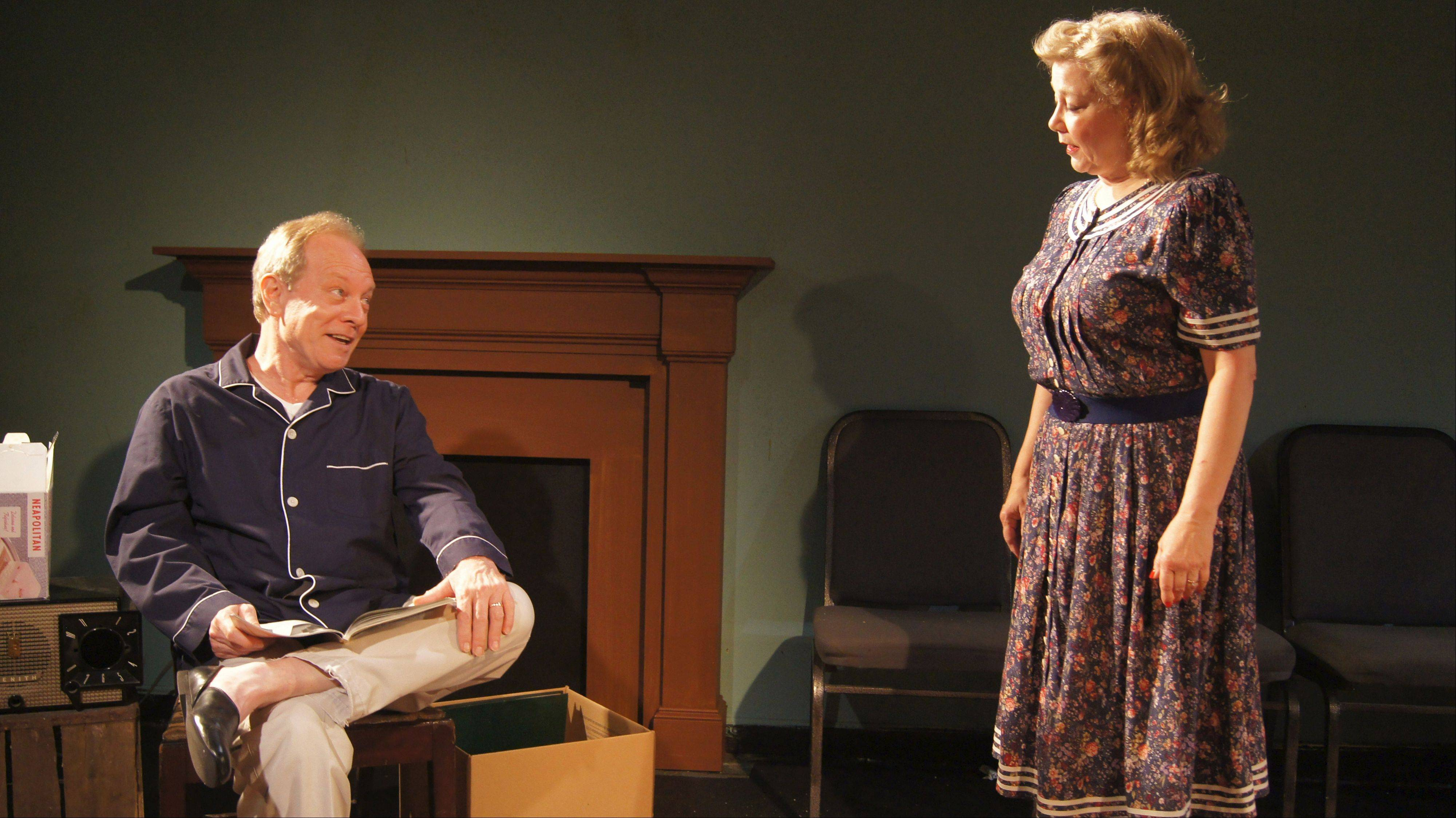 "Russ (Brian Parry) and Bev (Jan Ellen Graves) prepare to trade their longtime home in an all-white Chicago neighborhood for a place in the 'burbs in Bruce Norris' ""Clybourne Park,"" running through Nov. 10 at redtwist theatre."