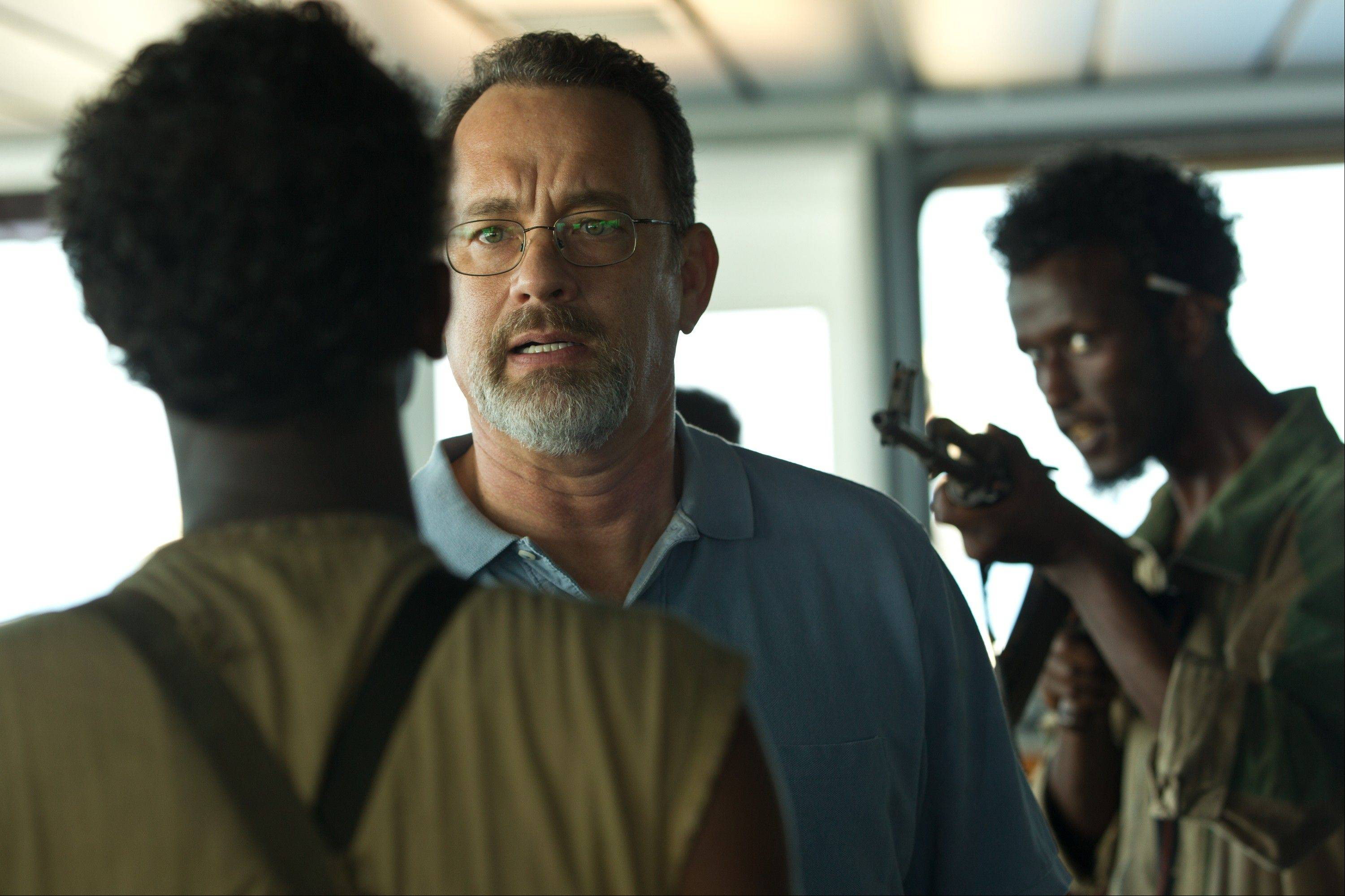 "Richard Phillips (Tom Hanks) confronts Somali pirates taking over his cargo ship in Paul Greengrass' fact-based suspense thriller ""Captain Phillips."""
