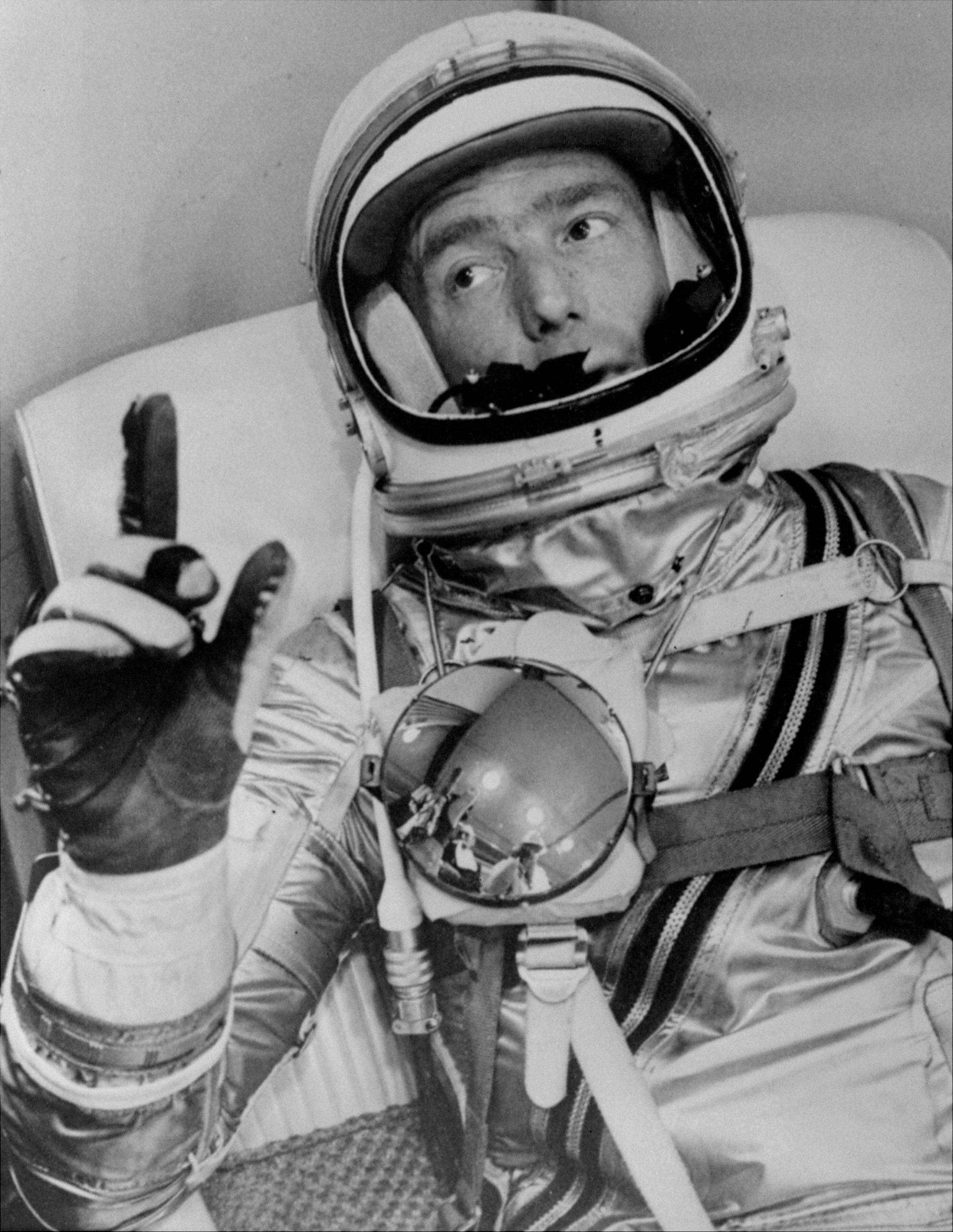 Astronaut Scott Carpenter gestures with one hand after donning his space suit in Hangar S prior to being shot into orbit at Cape Canaveral, Fla.