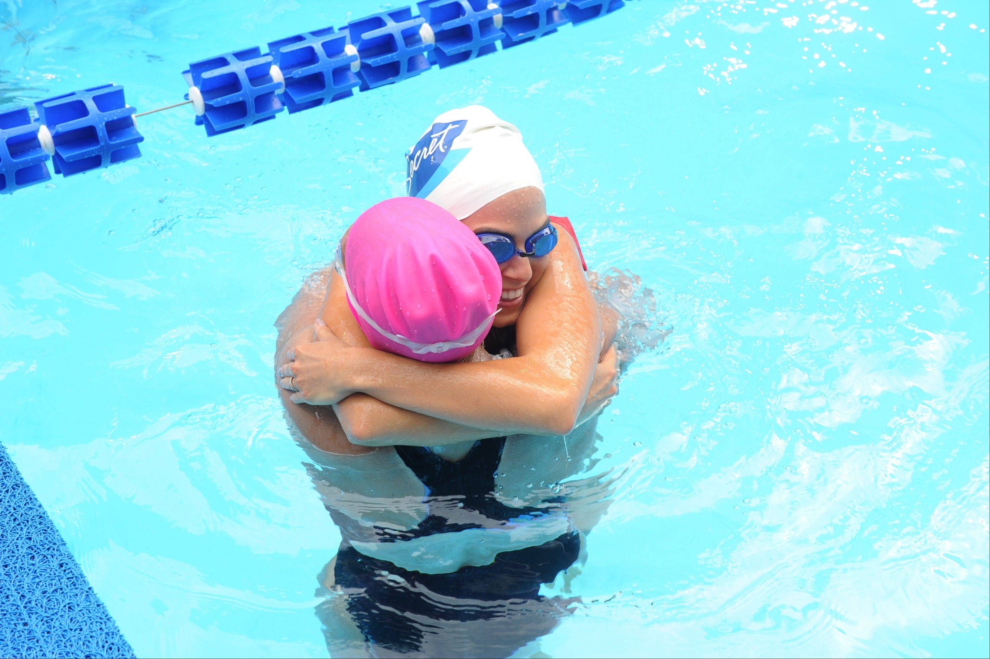 Associated Press/ Invision for P&G Actress Nikki Reed hugs long-distance swimmer Diana Nyad during her 48-hour continuous �Swim for Relief� to support Hurricane Sandy recovery efforts, Wednesday, Oct. 9, 2013, in New York�s Herald Square.