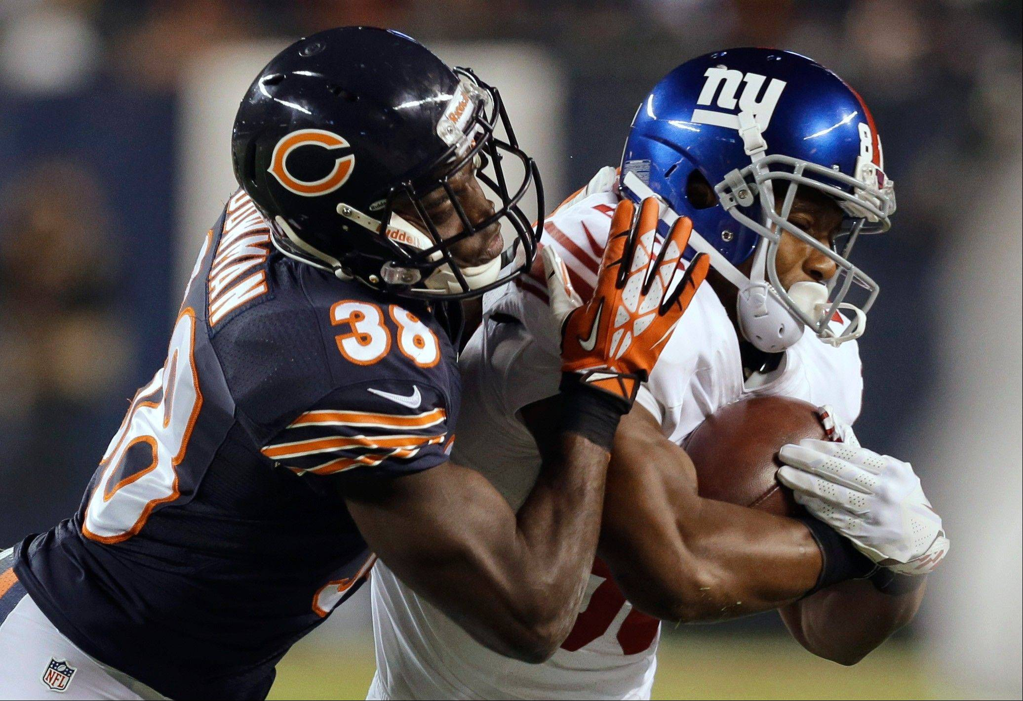 Chicago Bears defensive back Zack Bowman (38) tackles New York Giants wide receiver Victor Cruz during the first half of an NFL football game, Thursday, Oct. 10, 2013, in Chicago.