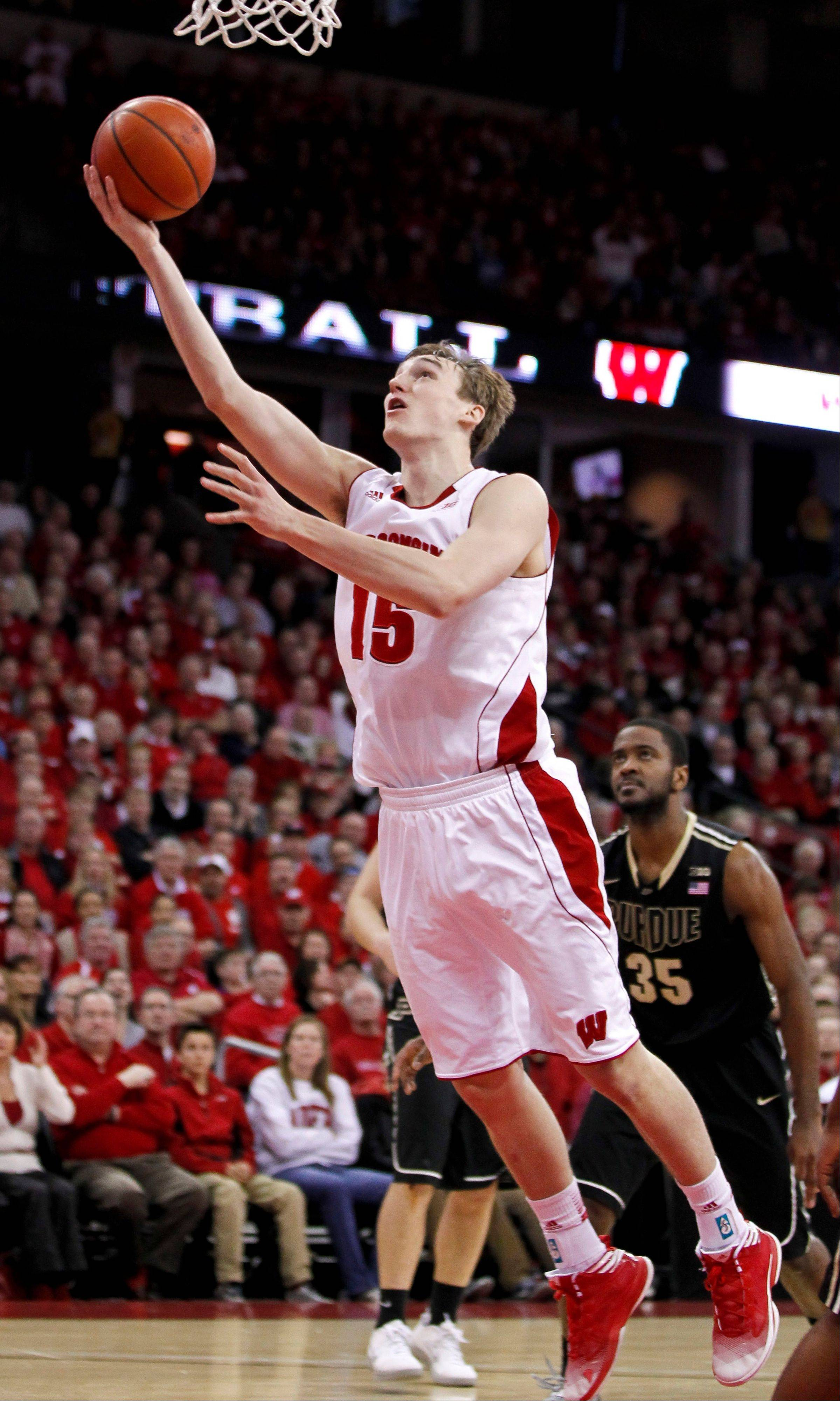 Wisconsin�s Sam Dekker goes to the basket against Purdue during a game in Madison, Wis. Dekker shot 41 percent from 3-point range in Big Ten play last year.