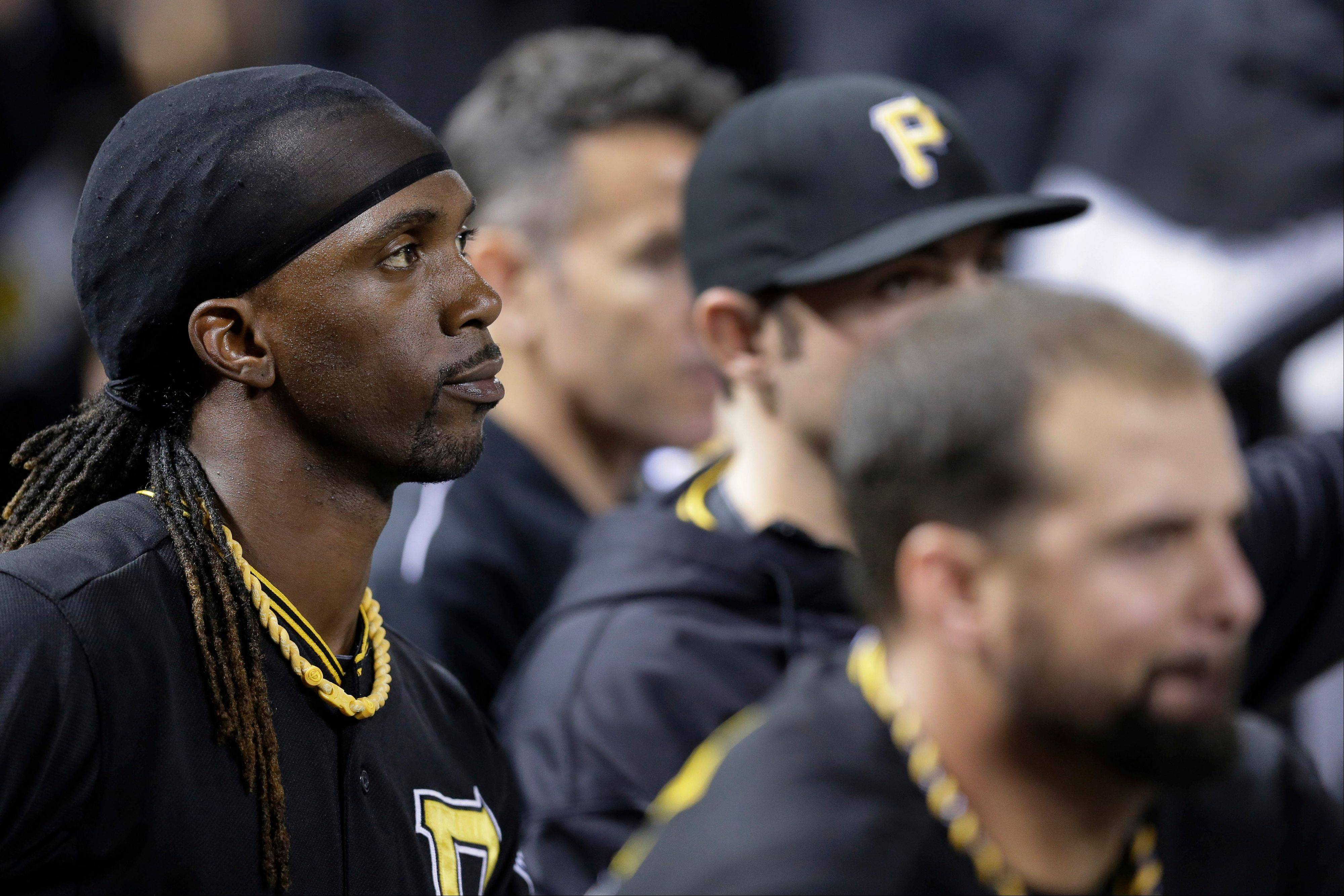 The Pirates� Andrew McCutchen, left, and his teammates watch from the dugout during the eighth inning of Game 5 of a National League Division Series against the Cardinals in St. Louis. The Cardinals won 6-1 and advanced to the NL championship series against the Los Angeles Dodgers.