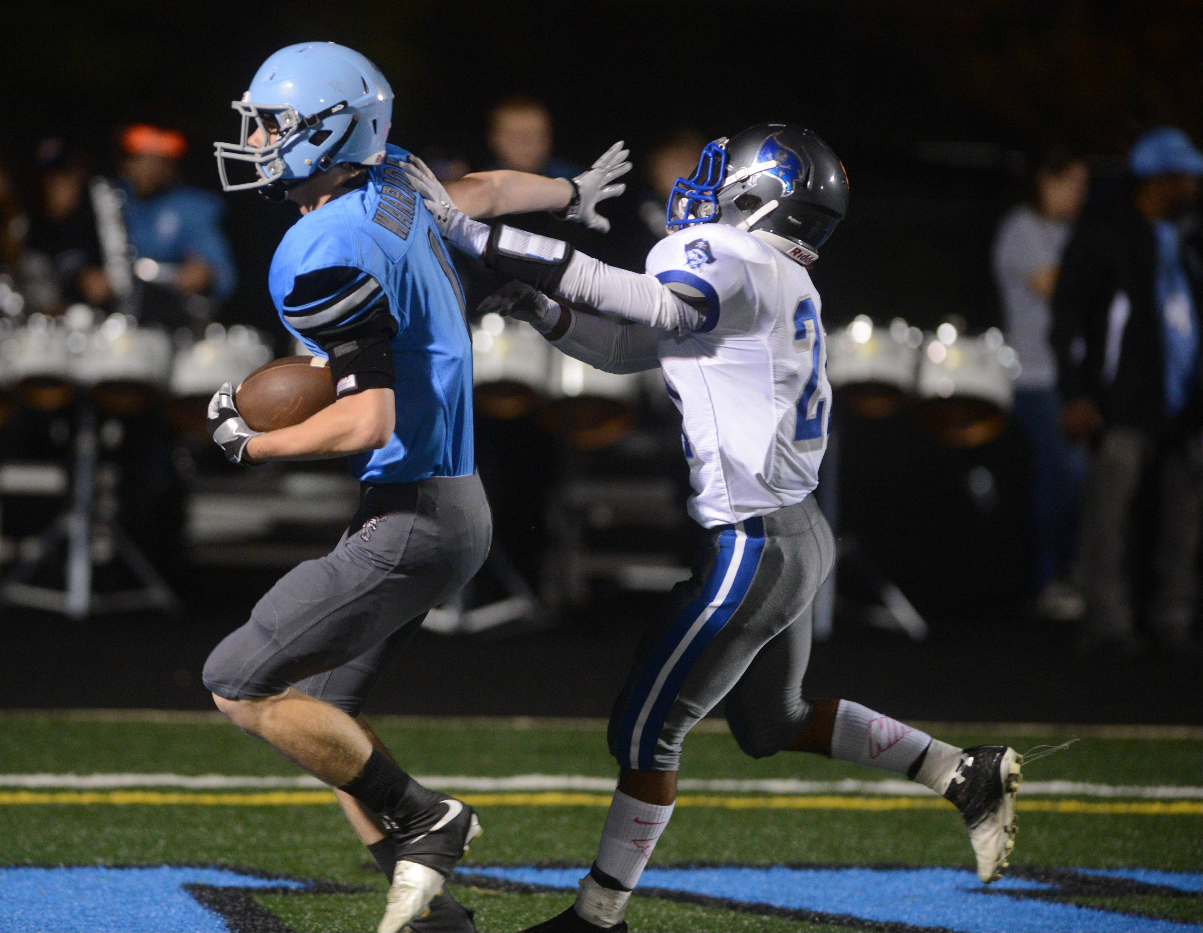 Hayden Adams of Willowbrook,left, and Kameron Irvin of Proviso East run during the Proviso East at Willowbrook football game in Willowbrook Friday.