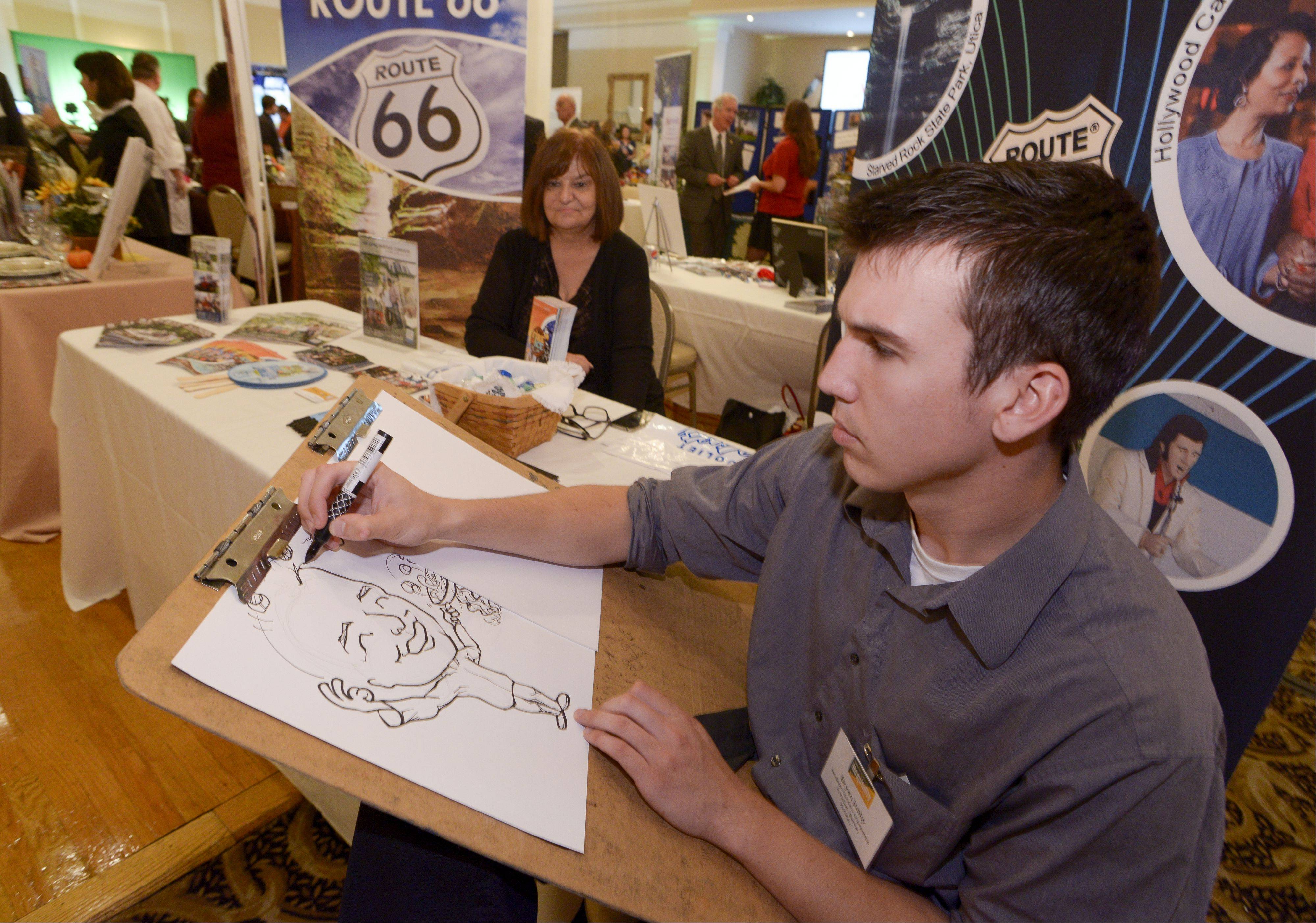 Bryan Janky draws a caricature during the Daily Herald Business Ledger's hospitality Expo at Abbington Distinctive Banquets in Glen Ellyn, Thursday.