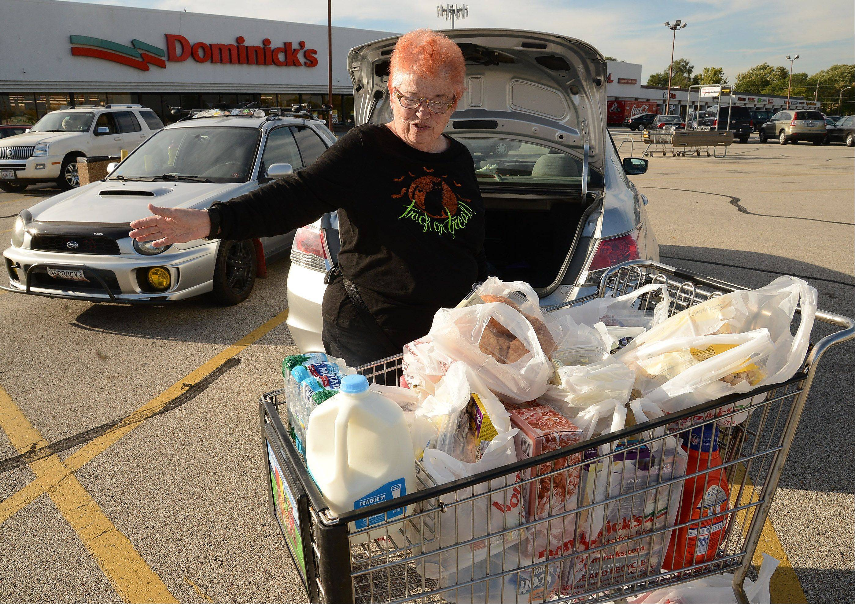 Pat Sconza of Mount Prospect, a Dominick's shopper for 40 years, bought $270 worth of groceries Thursday at the store at Golf and Elmhurst roads in Mount Prospect. She said she was upset the stores are being sold off or closed.
