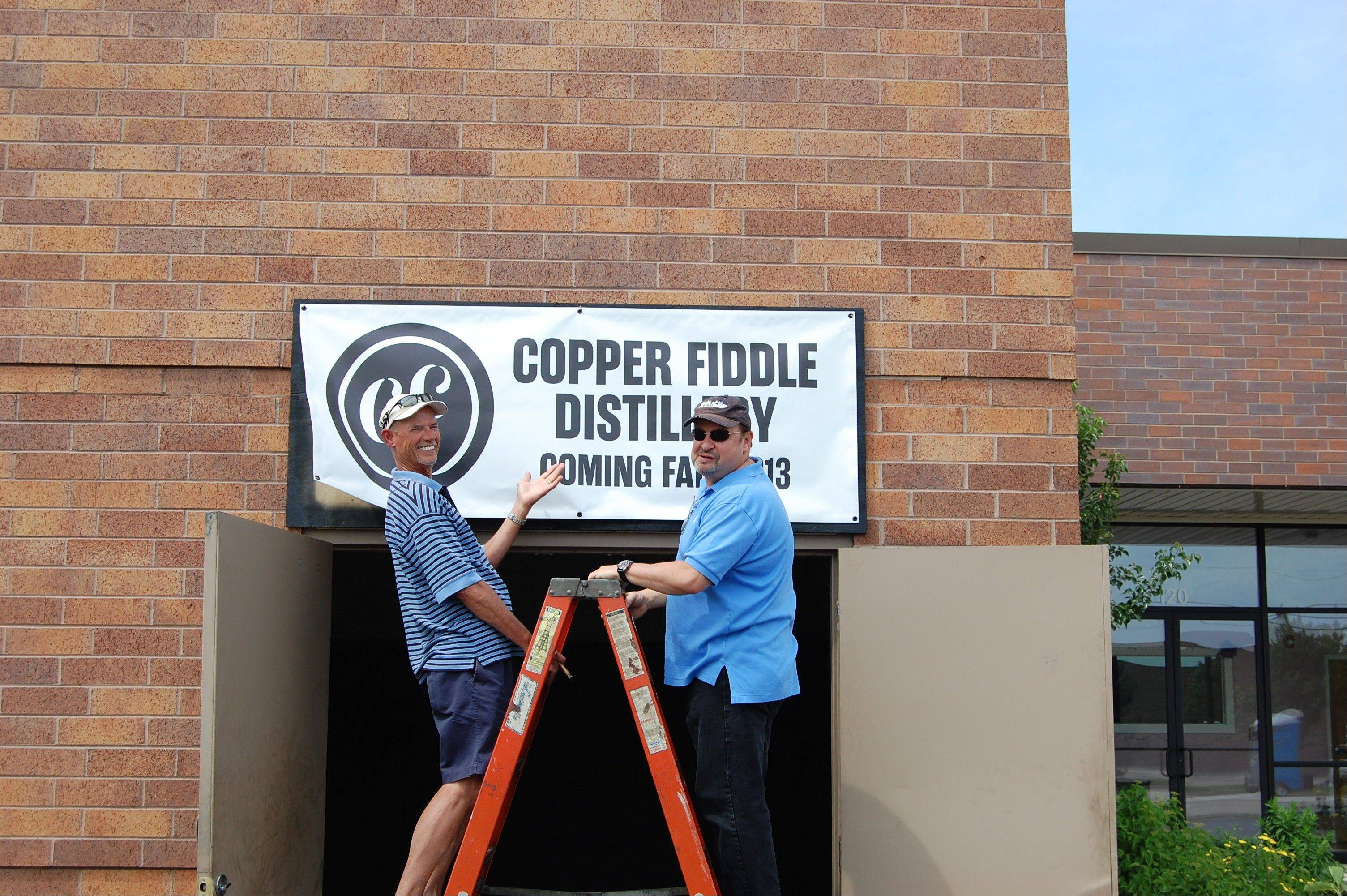 Fred Robinson, left, and Jose Hernandez at the building on Route 22 where they plan to open Copper Fiddle Distillery in Lake Zurich.