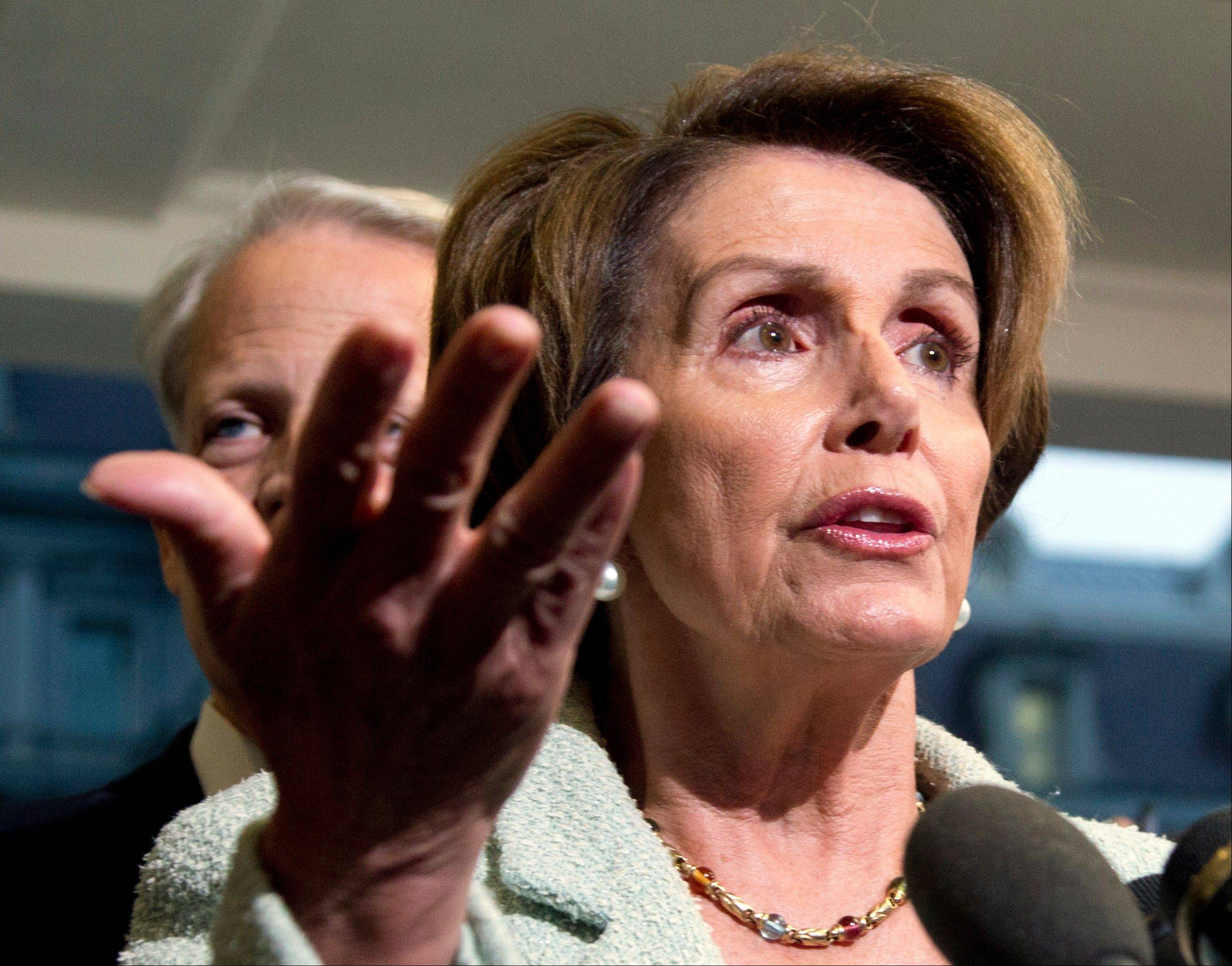 House Minority Leader Nancy Pelosi, D-Calif., with Rep. Steve Israel, D-N.Y., speaks to reporters during a news conference following a meeting with President Barack Obama at the White House in Washington, Wednesday.