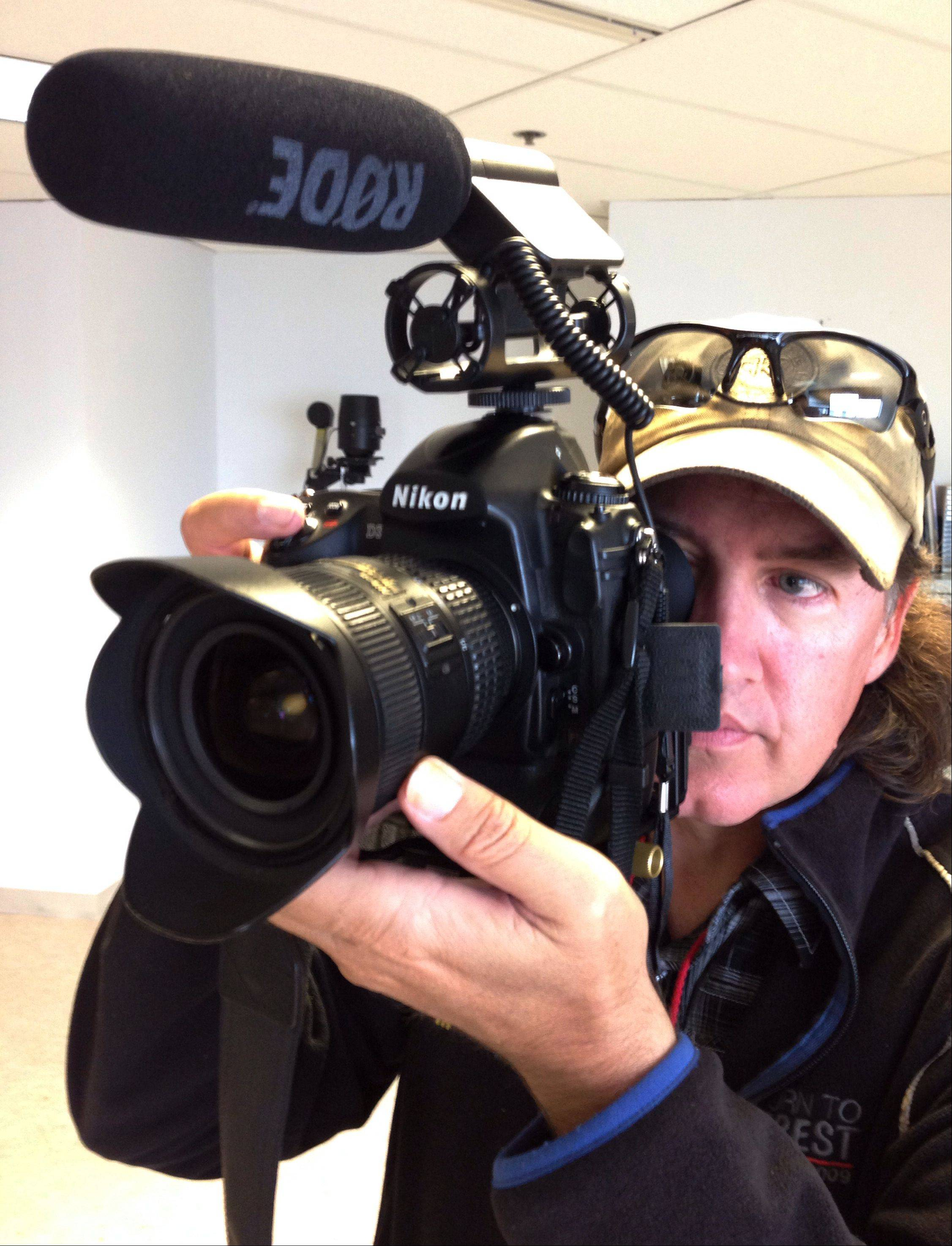 Daily Herald photojournalist Mark Welsh uses the latest digital video technology. The DSLR camera will shoot still images as well as high definition video.