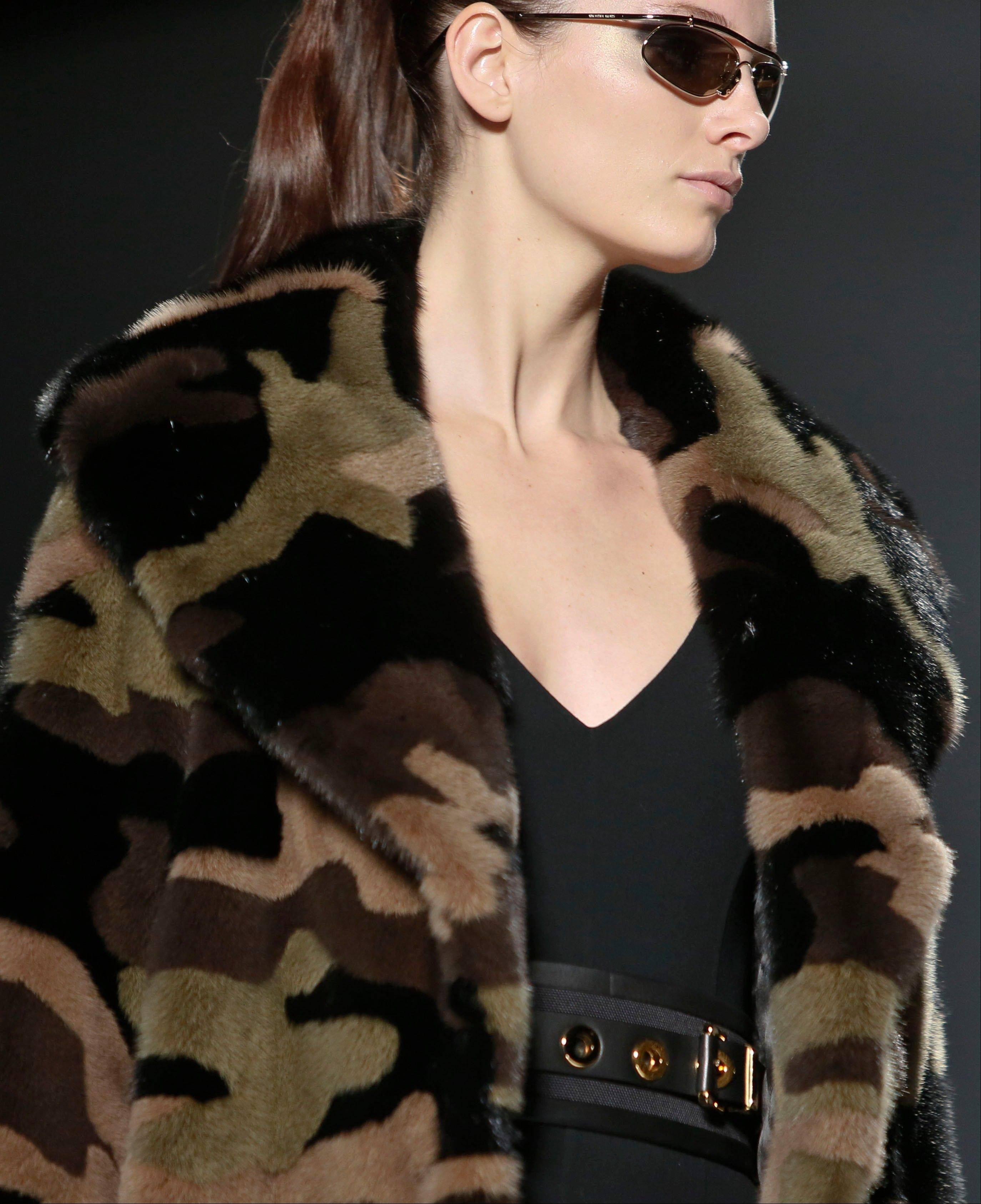 The print that at one time was only a tool for military troops to go unnoticed has become a front-and-center look in fashion, such as this camouflage fur coat from the Michael Kors Fall 2013 collection.