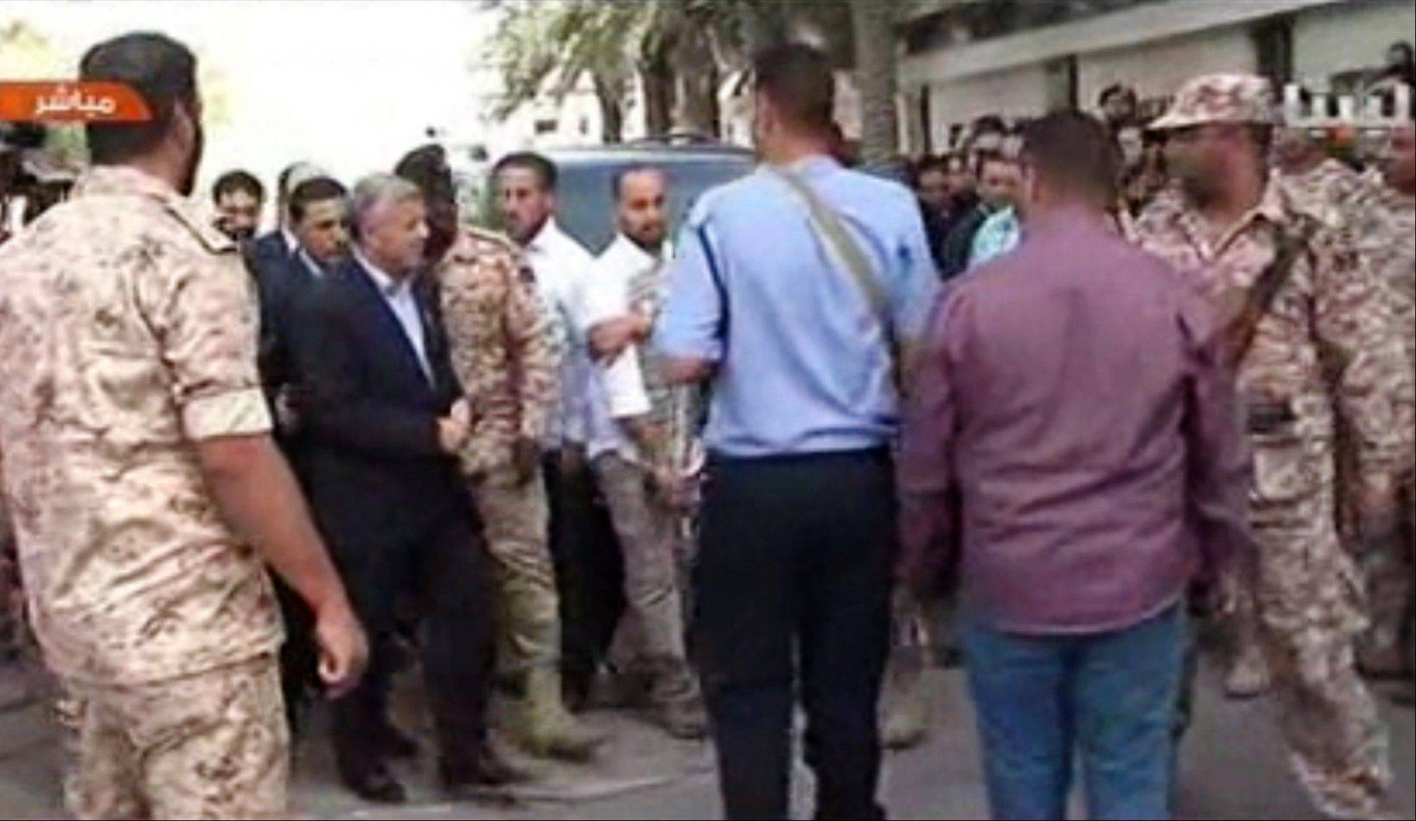 In this image made from video, Libyan Prime Minister Ali Zidan appears on a Libyan TV as he arrives at his cabinet office Thursday in his first public appearance after being abducted by gunmen from his hotel earlier in the day.