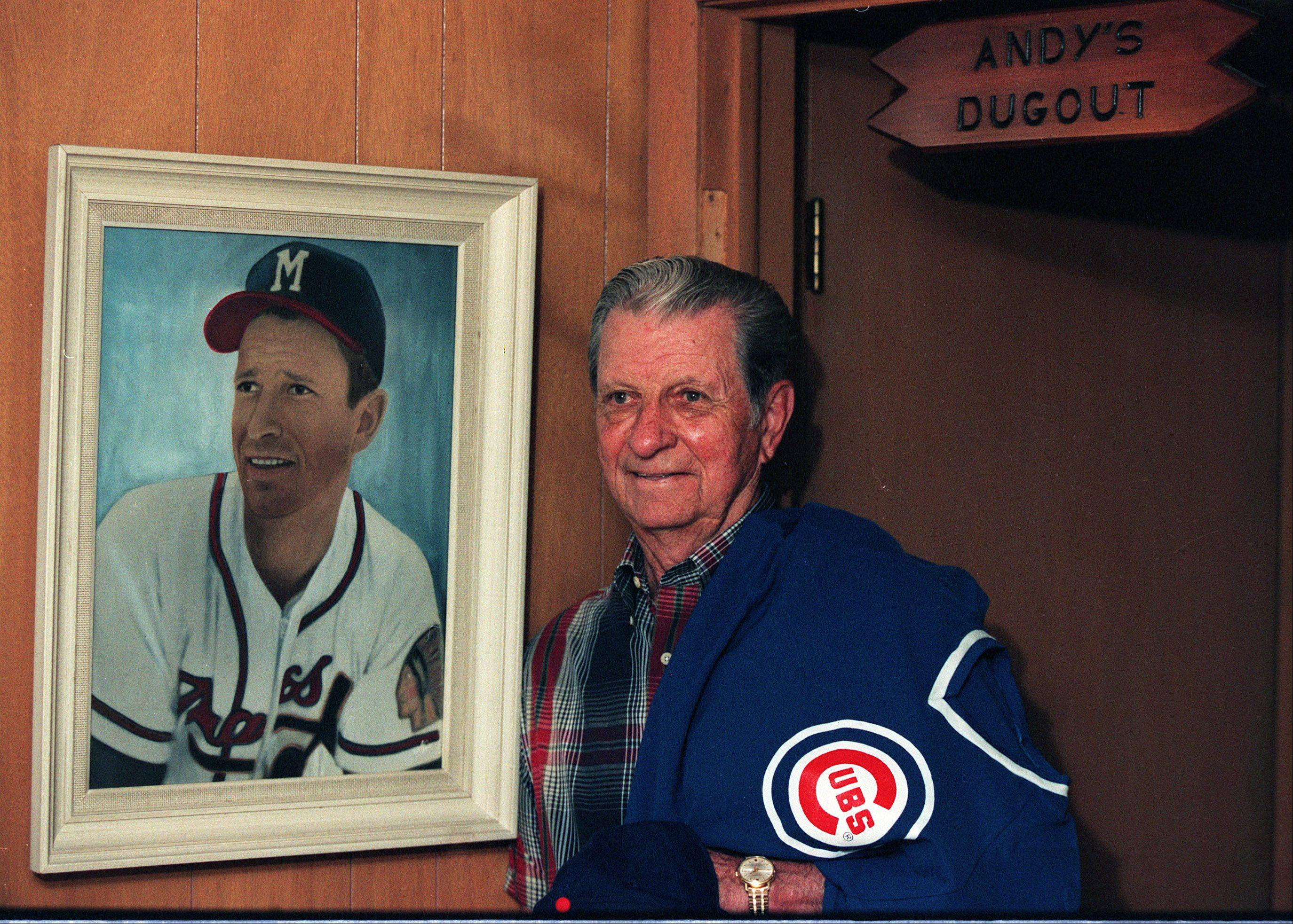 At his home in Mount Prospect, former Chicago Cub Andy Pafko poses with a portrait of him as a Milwaukee Brave.